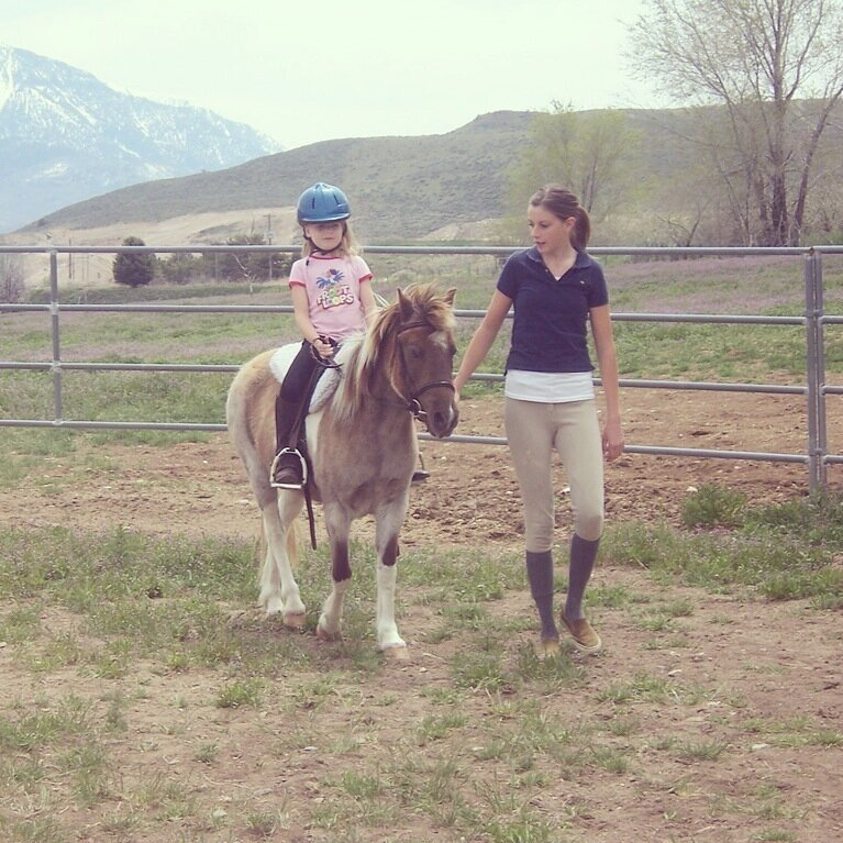 Me at 15 with my first student-my neice Heidi. She's riding one of my mom's welsh ponies, Cookie