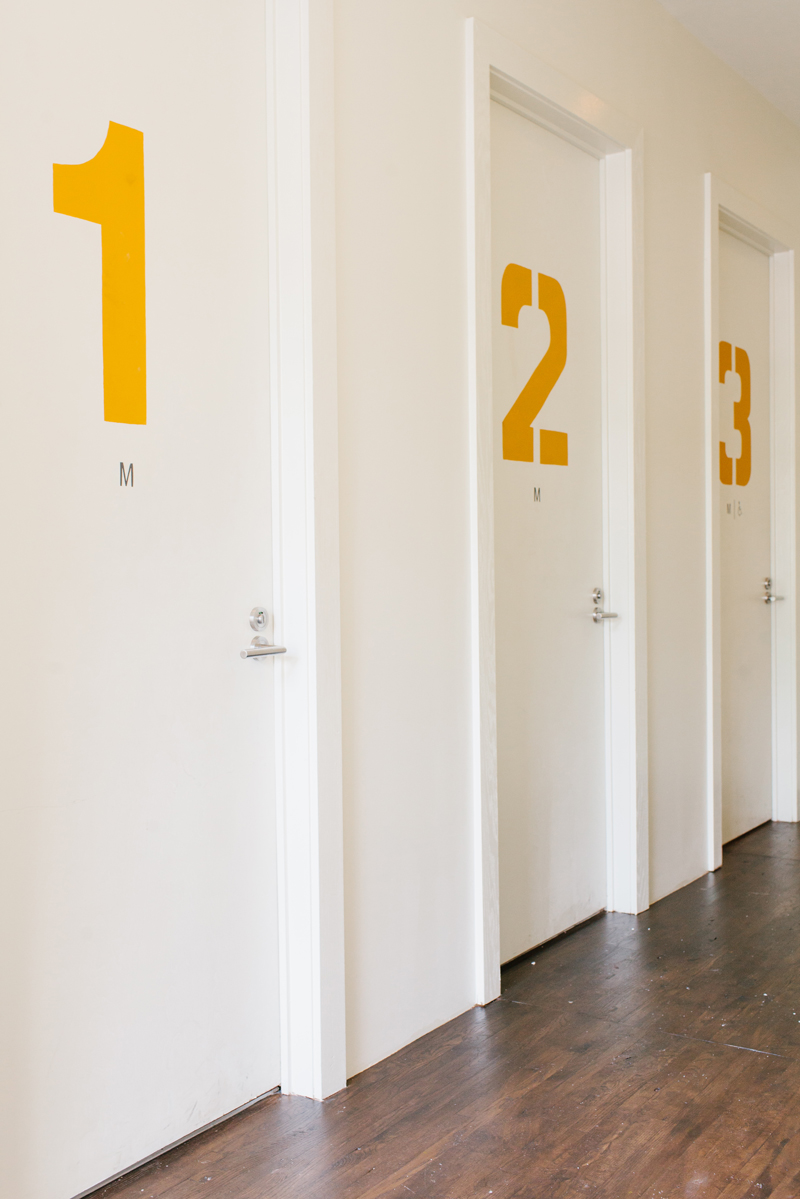 The Optimist | Smith Hanes. restaurant bathroom doors, stencil numbers