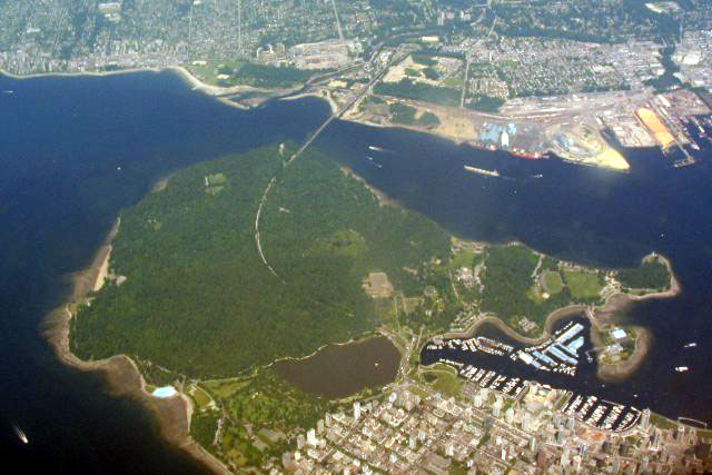 Here is an aerial picture of Stanley Park taken by Derek K. Miller in 2002. Downtown Vancouver is below and to the right of the park, and North Vancouver is across the bridge, at the top of the image.