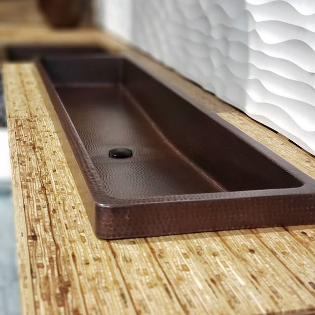 Hammered copper sinks really show nicely.  #kbis2019 #kitchensdesignedforlife #troughlife #ourfeetaregettingsore