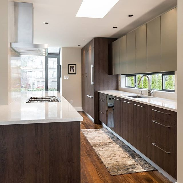 "Happy BC Day long weekend! To celebrate, check out some pictures from our Marine Drive renovation in West Vancouver. Dark oak, matte backpainted glass, and Cambria ""Ironsbridge"" give rich and soothing accents to the space.  See more projects at www.reynoldscabinetshop.com  Designer: Stephanie Kantonen General Contractor: @tandem.construction  #kitchensdesignedforlife #millwork #westvancouver #backpaintedglass #darkoak  @nickelscabinets @cambriasurfaces"