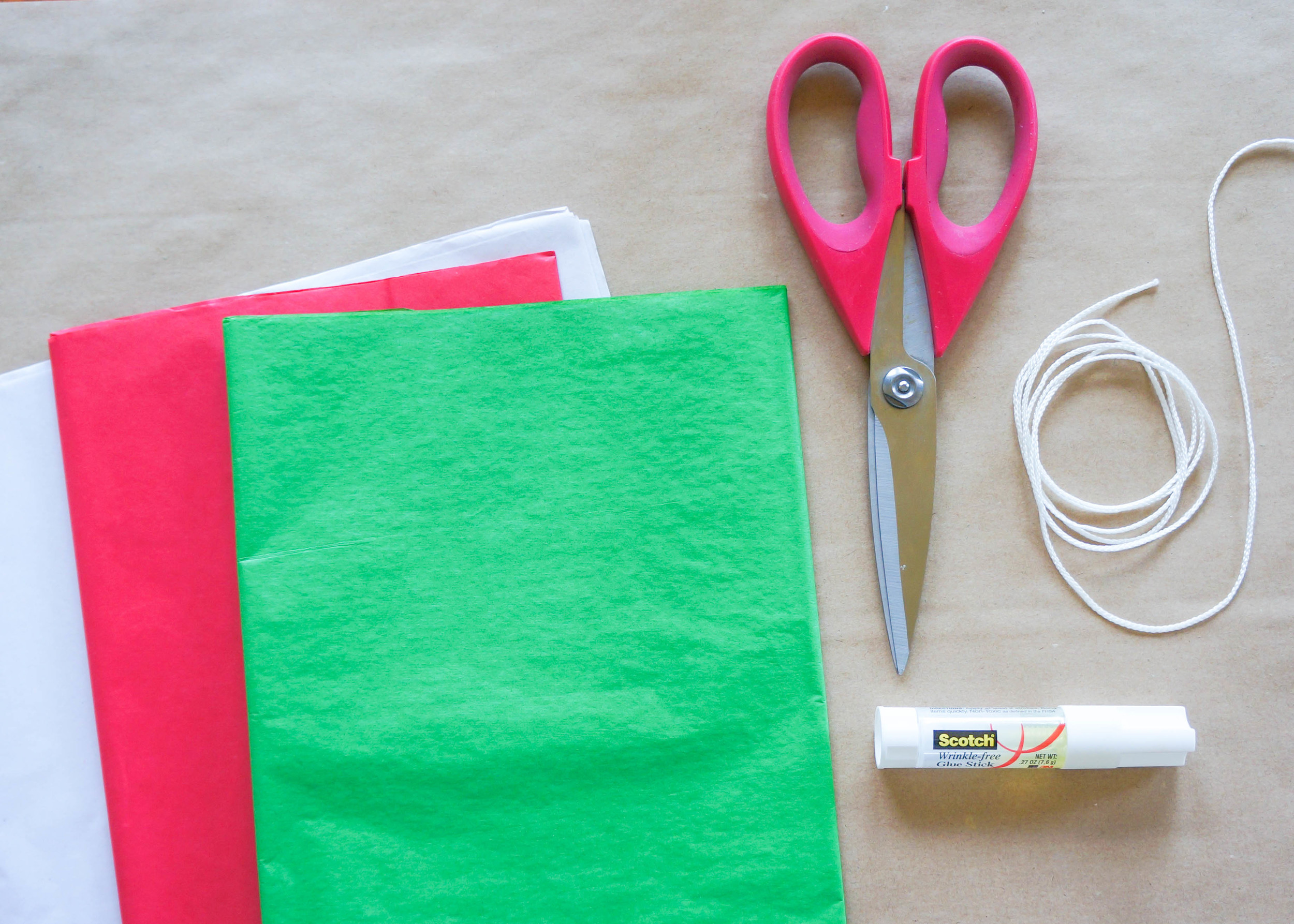 -Tissue paper, of any color. In fact, the more colors you have the better your Papel Picado (Perforated Paper) will look!  -String. Any string will work but I would suggest something thicker than sewing string.  -Scissors  -Glue stick