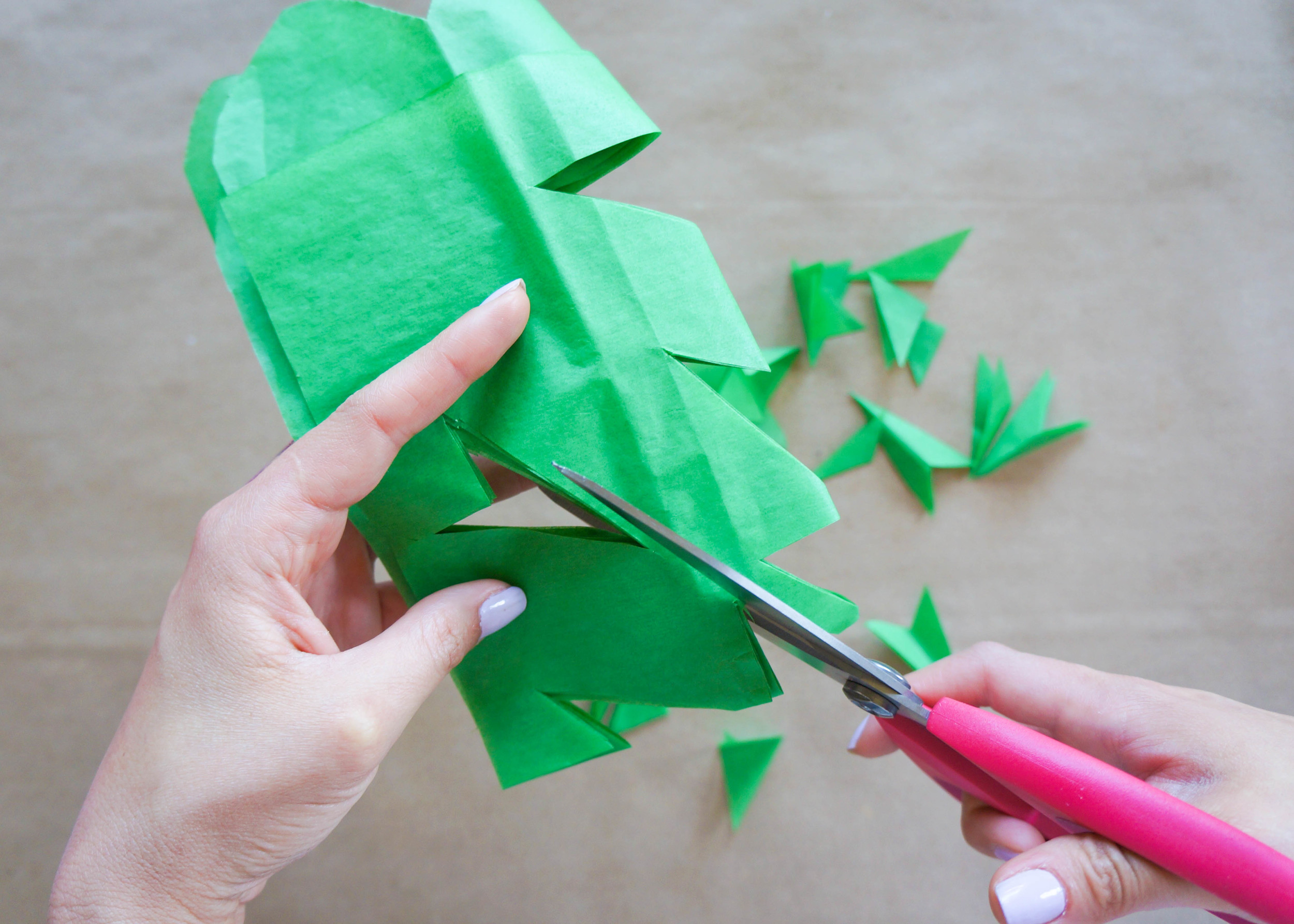 Now here is where the magic happens! Think back to grade school, during the winter months, when you had to turn an ordinary piece of paper into a beautiful snowflake! At this point, anything goes, as long as you don't cut chunks out of your cute scalloped edge.