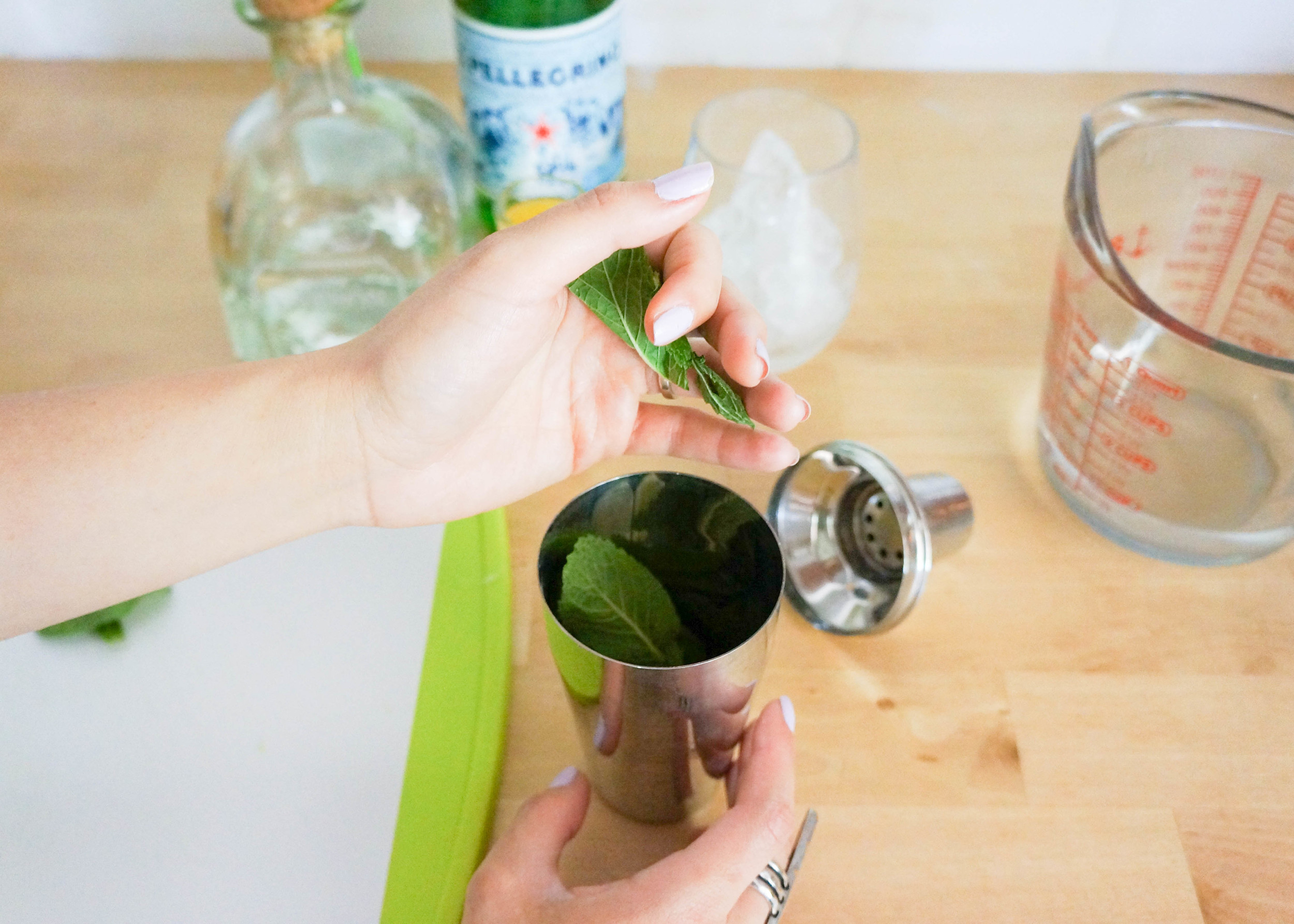 Combine Simple Sugar, jalapeno, mint and lime wedges in a cocktail shaker and muddle.