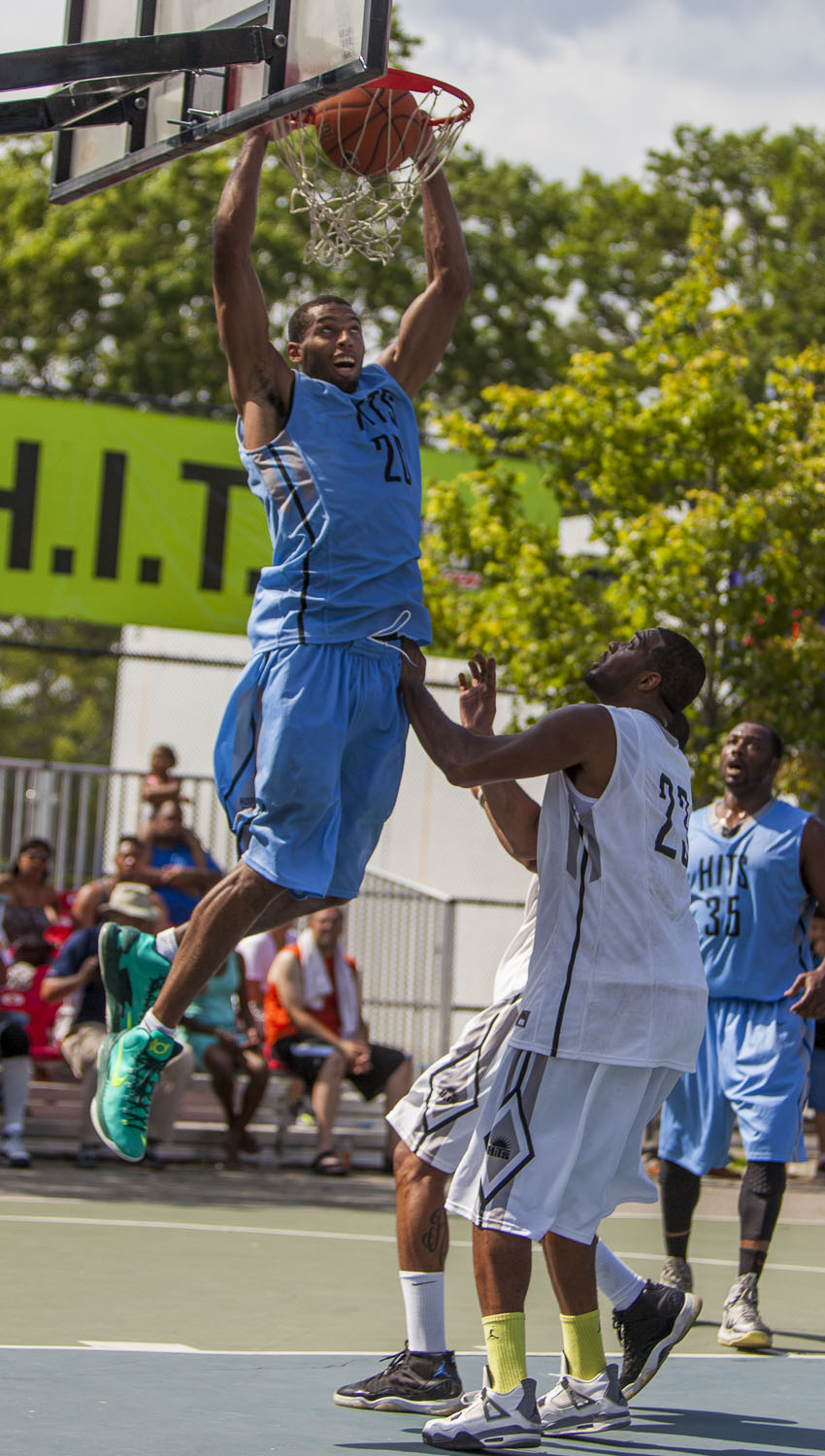 """Quinton """"T2"""" Hosley, who played for the storied 'Team Nike' last summer, rises for two of his 24 points for Skull Gang in a losing effort."""