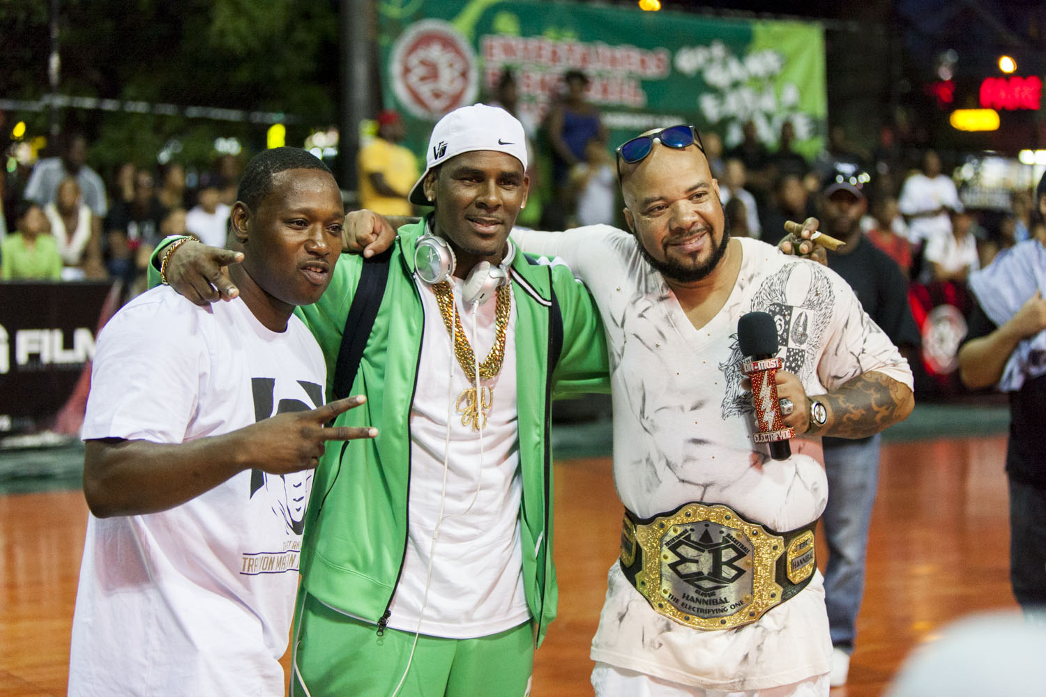 Multi-platinum recording artist R. Kelly showed up to Holcombe Rucker Park to take in the streetball action.