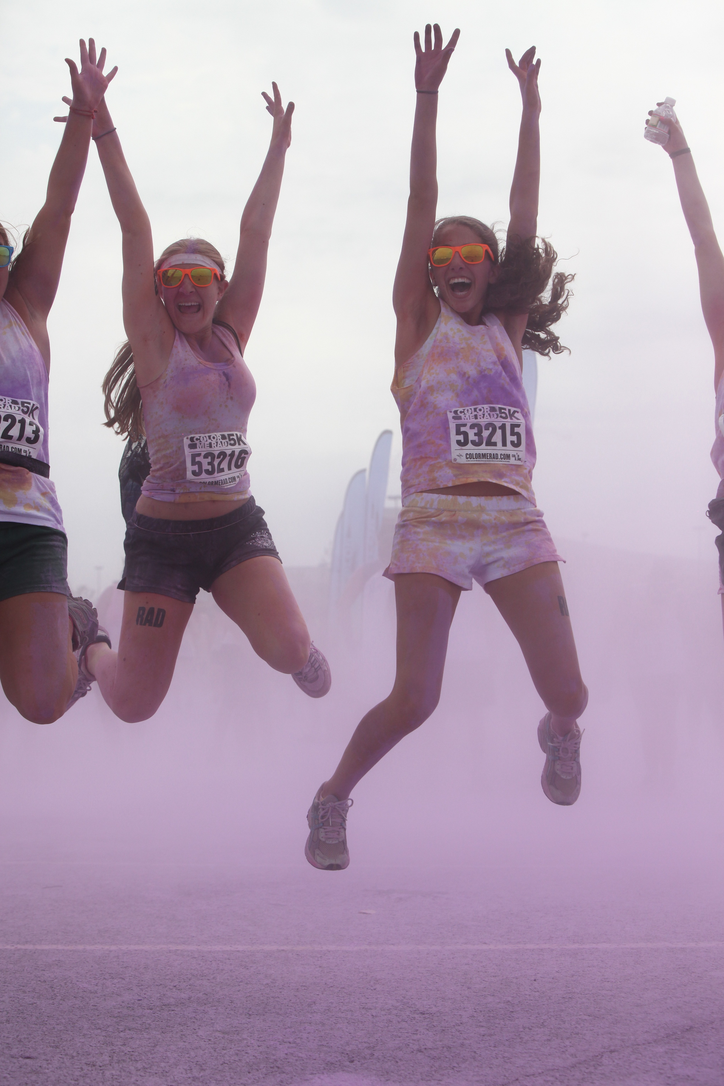 Runners take a leap for the photo op at the Color Me Rad run in New Jersey.