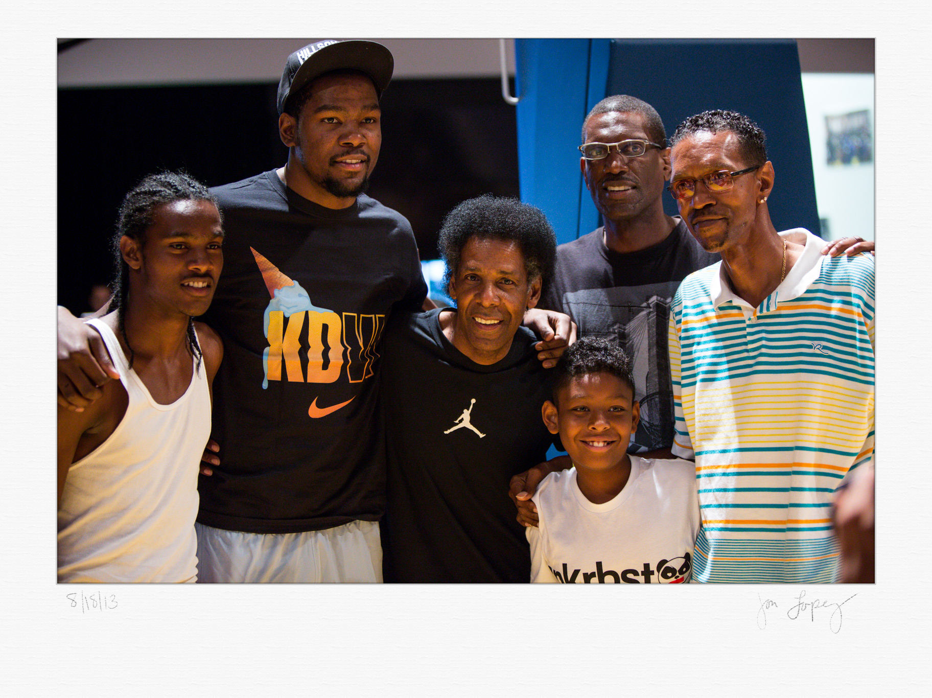 """Kevin Durant was highly sought after for photos and autographs and he obliged most of the requests including this one with playground legends Pee Wee Kirkland (center with Jordan shirt) and James """"Fly"""" Williams (far right)."""