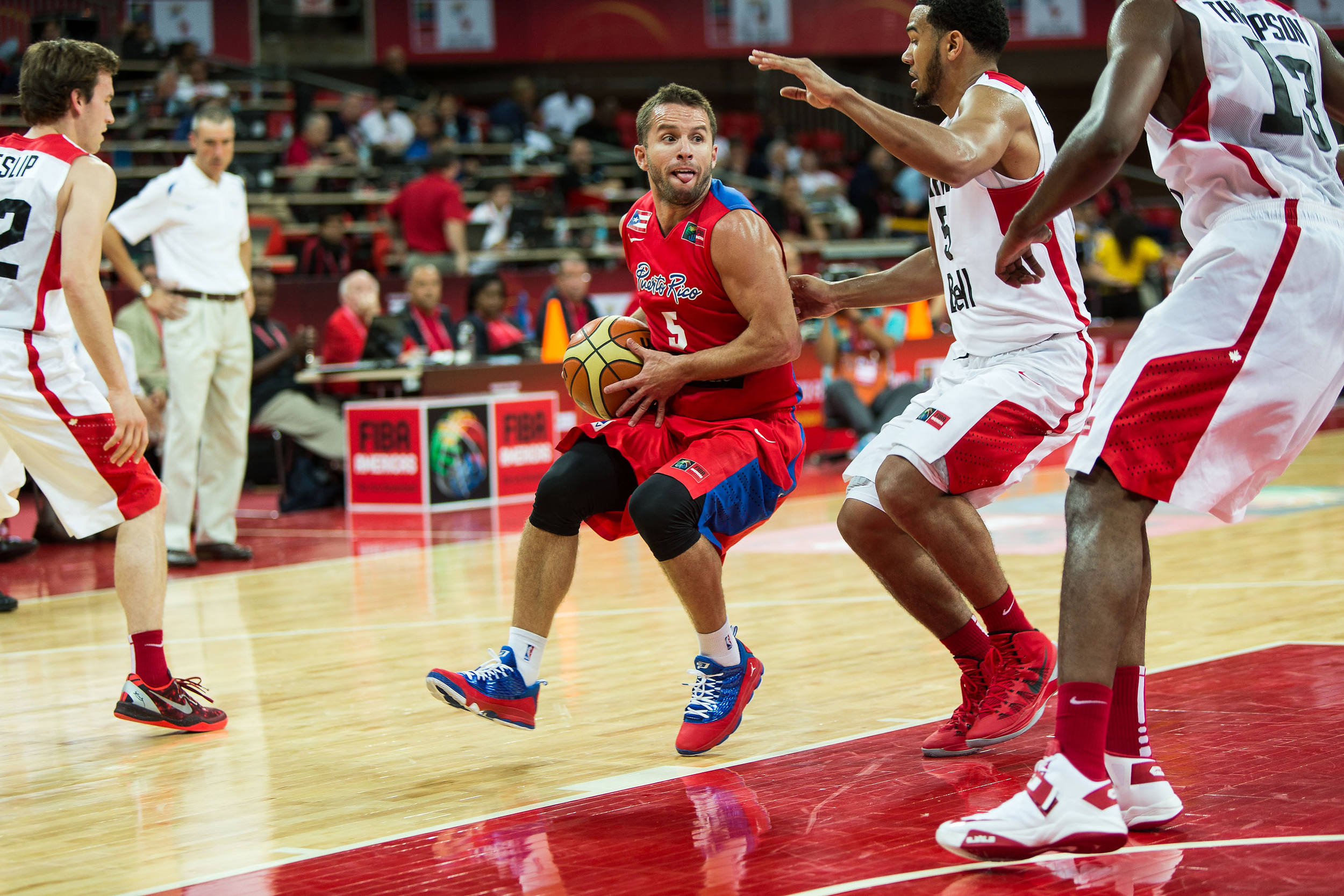 J.J. Barea (Puerto Rico) drives down the lane against Canada at the FIBA Americas Championship in Caracas, Venezuela