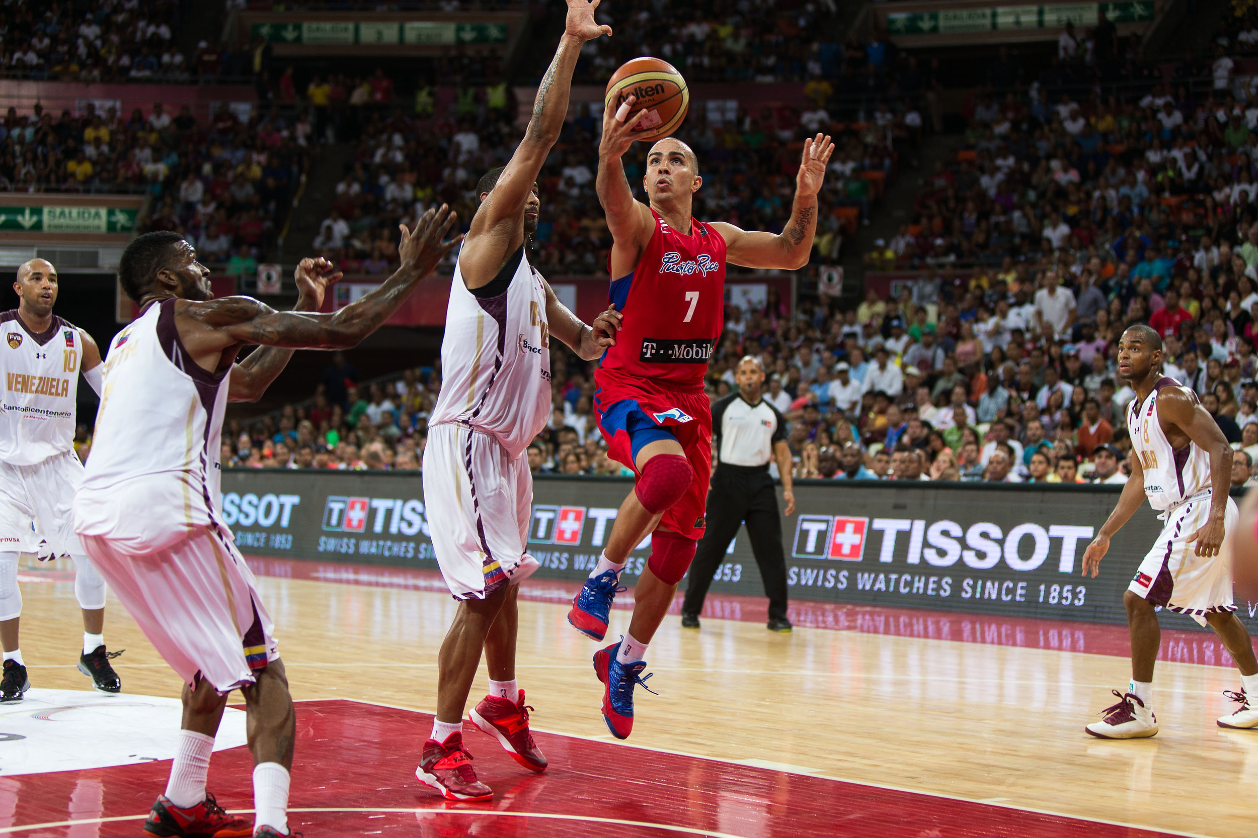 Carlos Arroyo is the face of Puerto Rico basketball. You may recall the iconic image of him popping his jersey in celebration of Puerto Rico's victory over Carmelo Anthony, LeBron James and team U.S.A. in 2004.