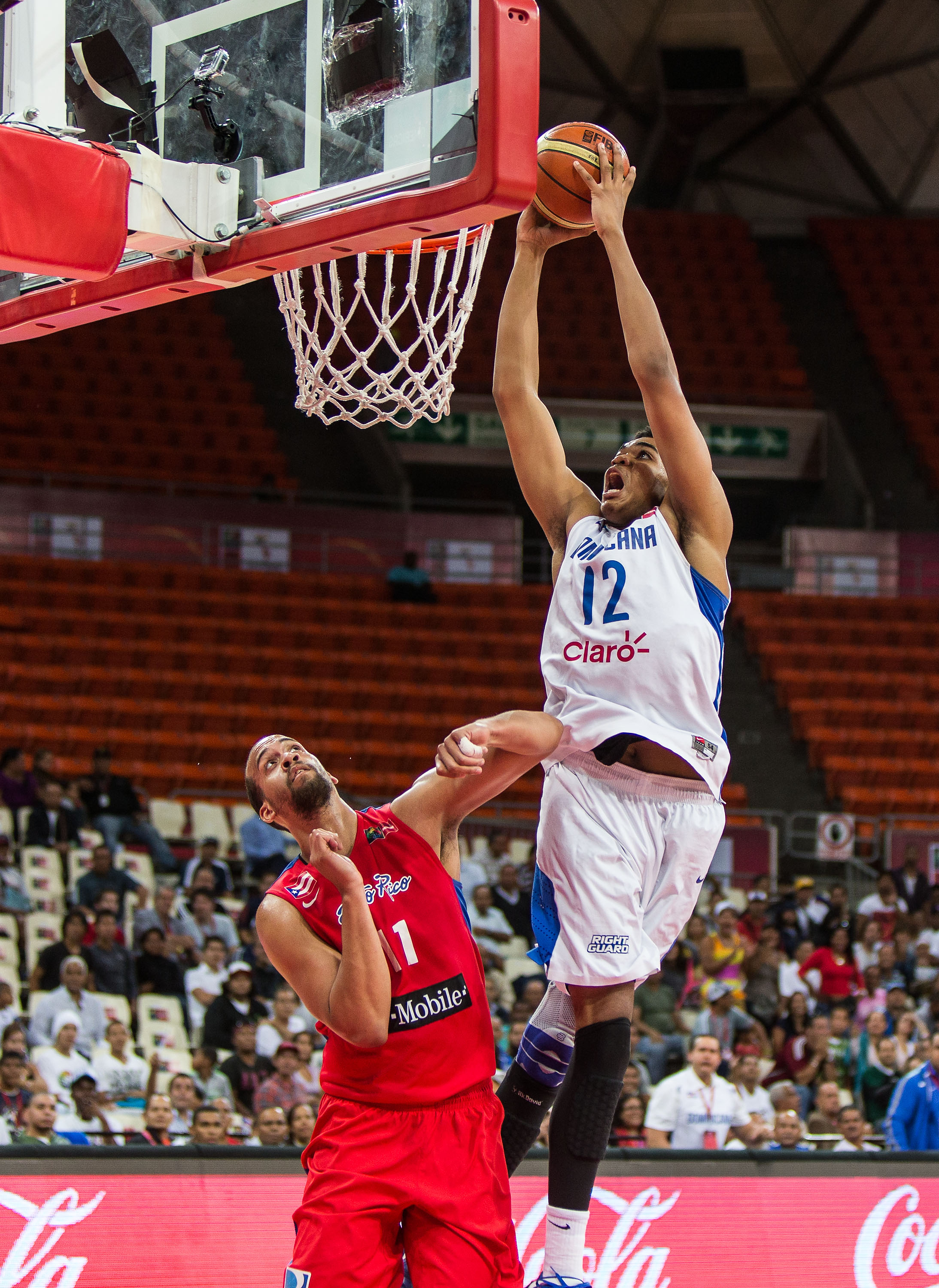 The 7-foot-1 17-year-old Karl Towns of the Dominican Republic elevates over Puerto Rico's defense during the rivalry game.