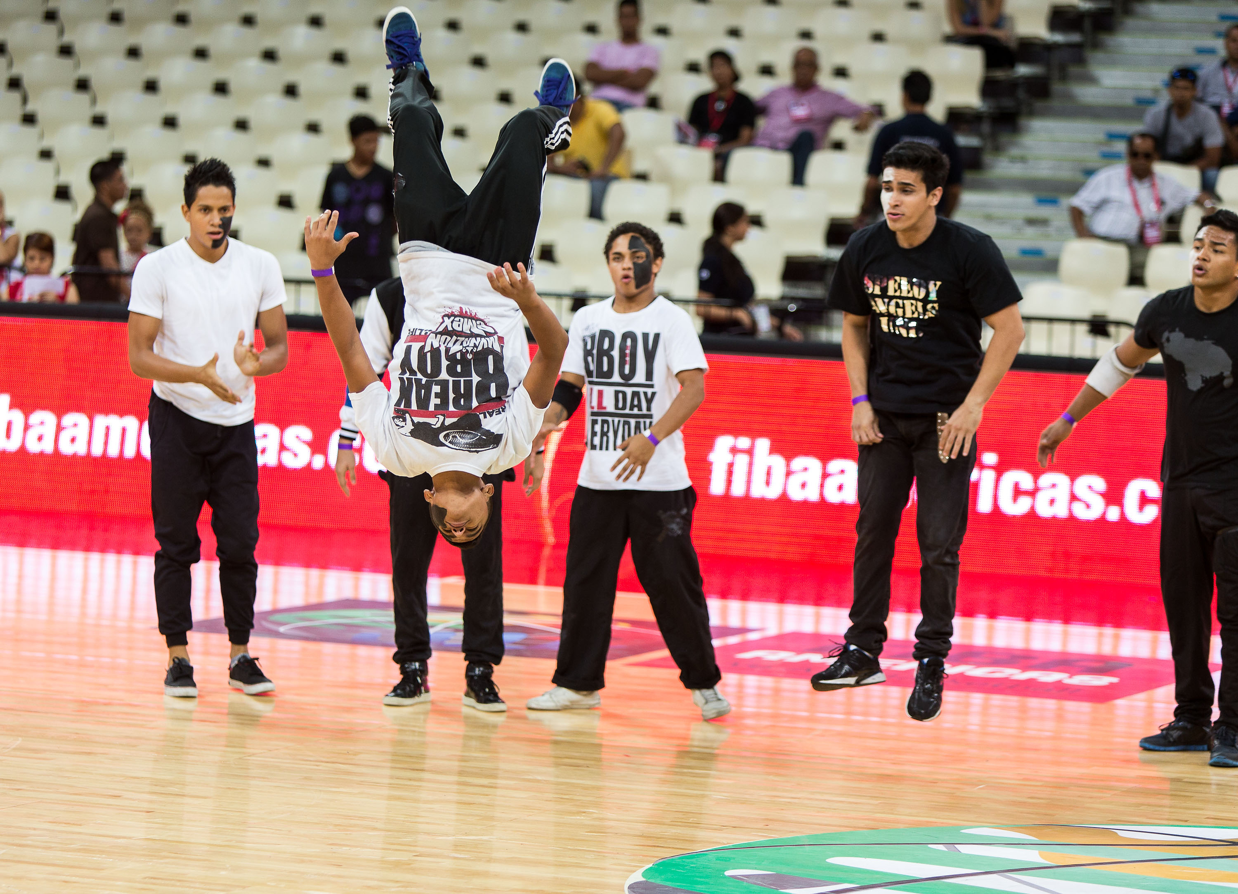 The halftime entertainment was pretty impressive. Here, breakdancers go airborne with some slick moves.