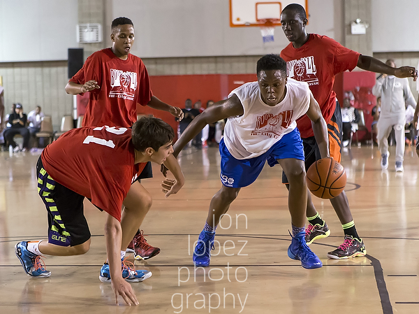 Cahiem Brown puts a debilitating move on thedefense at the 2014 Books & Ball All-City game in the Bronx, NY.