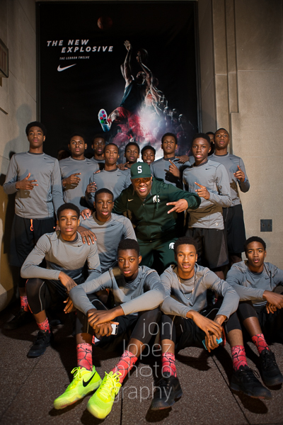The world's top-ranking motivational speaker, Eric Thomas, poses with the two teams on the eve of the IS 8 championship game.