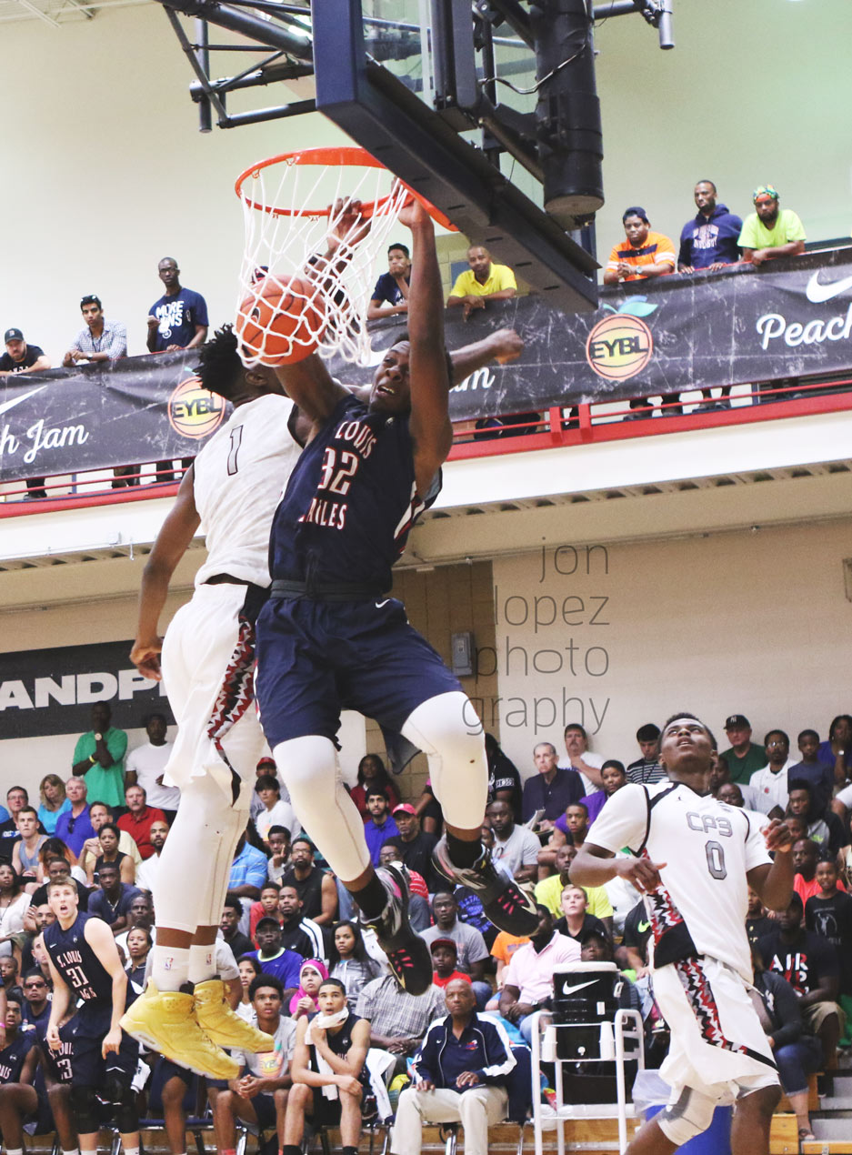 Tyler Cook challenges Harry Giles at the rim during a memorable final four matchup between Team CP3 and the St. Louis Eagles.