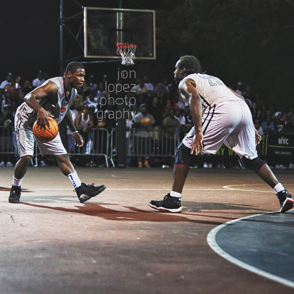 Former Florida Gator, Erving Walker (with the ball in hand) took on former Pitt standout, Levance Fields in a memorable battle on the court at Gersh Park.
