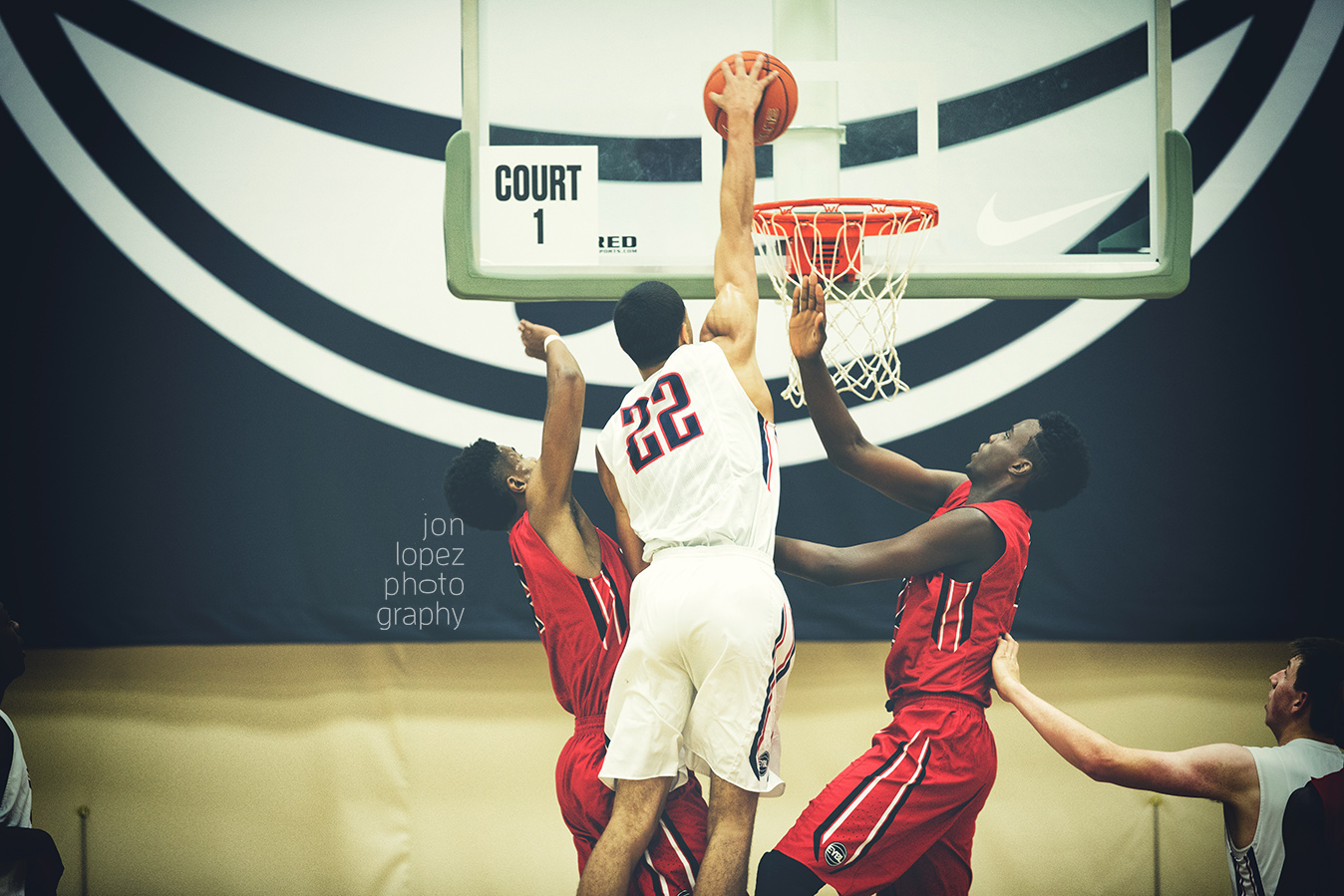 Jayson Tatum rises up for a dunk attempt over two defenders at session 4 of the EYBL in Minneapolis, MN.