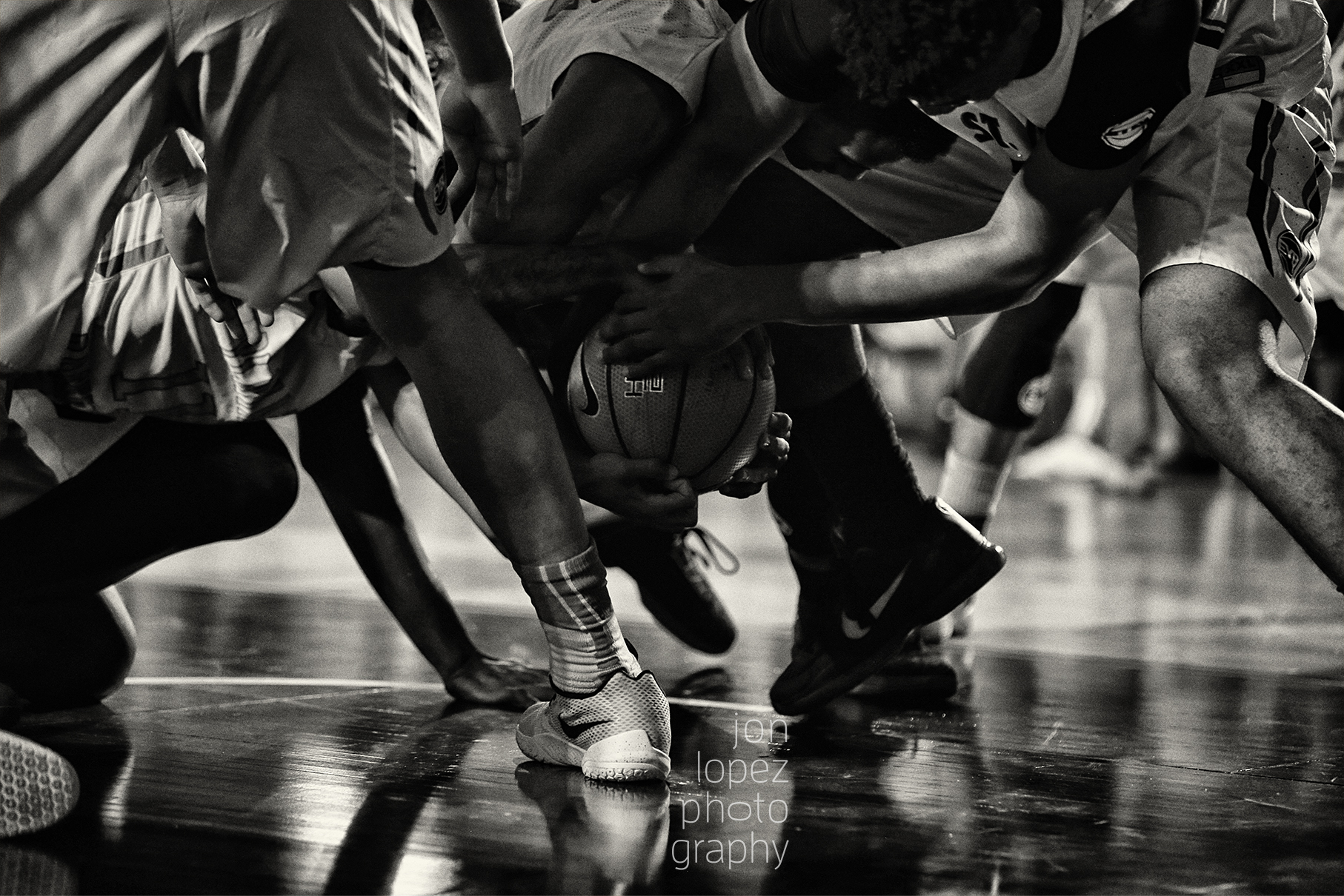 Players battle for possession during session one of the EYBL at the Brooklyn Cruise Terminal. I loved the dramatic lighting in this shot.
