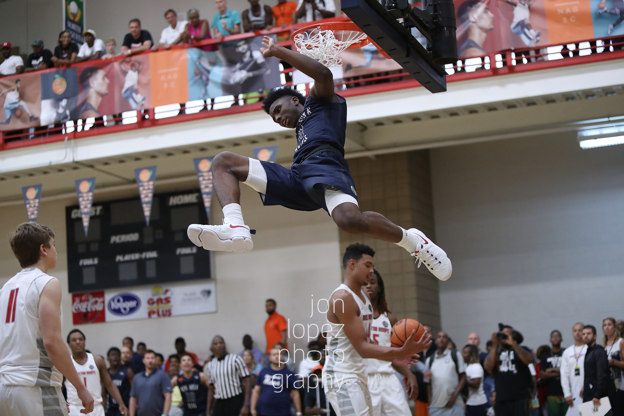 New York Rens standout guard and Queens, NY native Hamidou Diallo may have been the most exciting player to watch in the EYBL in 2016. Here he double pumped to avoid a block, absorbed contact, and still threw it down much to the delight of his teammates and the crowd.
