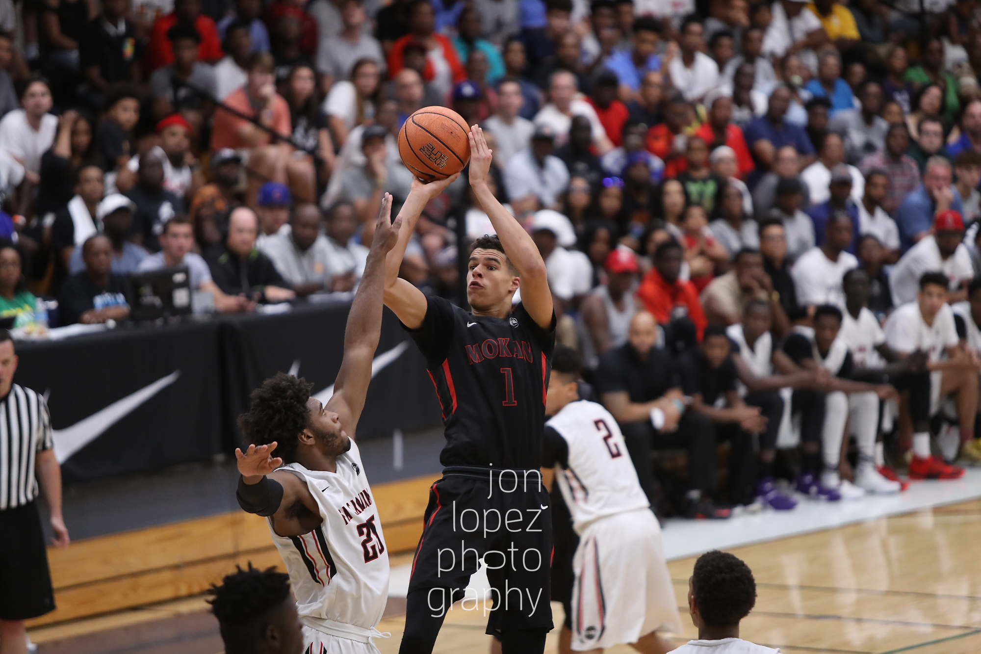 Mokan Elite's Michael Porter was possibly the EYBL's most complete player. Here he pulls up for a jumper over the outstretched hands of the defense en route to winning Peach Jam 2016.