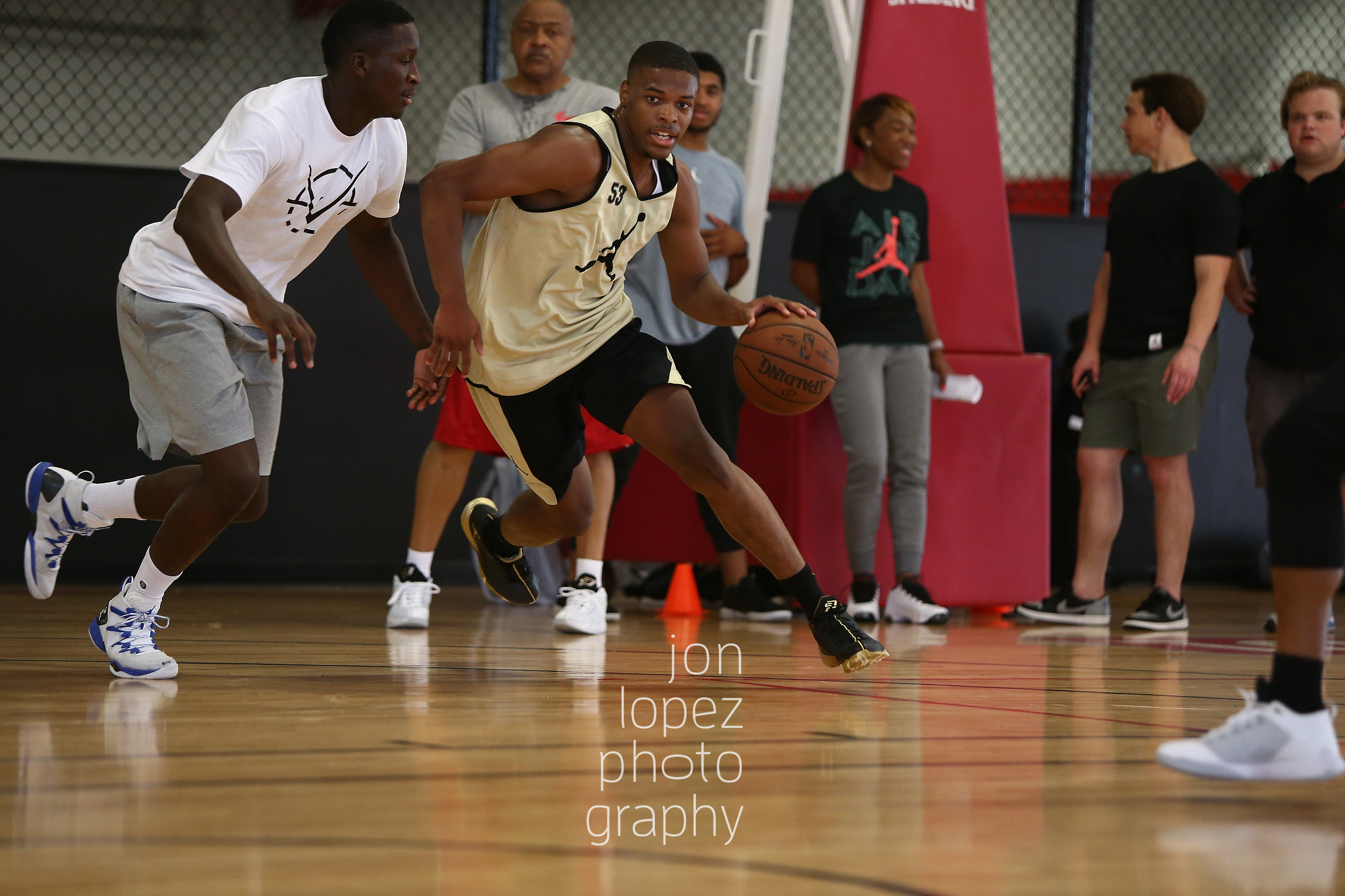 With CP3 nursing a hand injury, Victor Oladipo took on the challenge of giving the top point guards in America some hands on experience with NBA talent. Here Dennis Smith dribbles while being defended by the Oklahoma City guard.