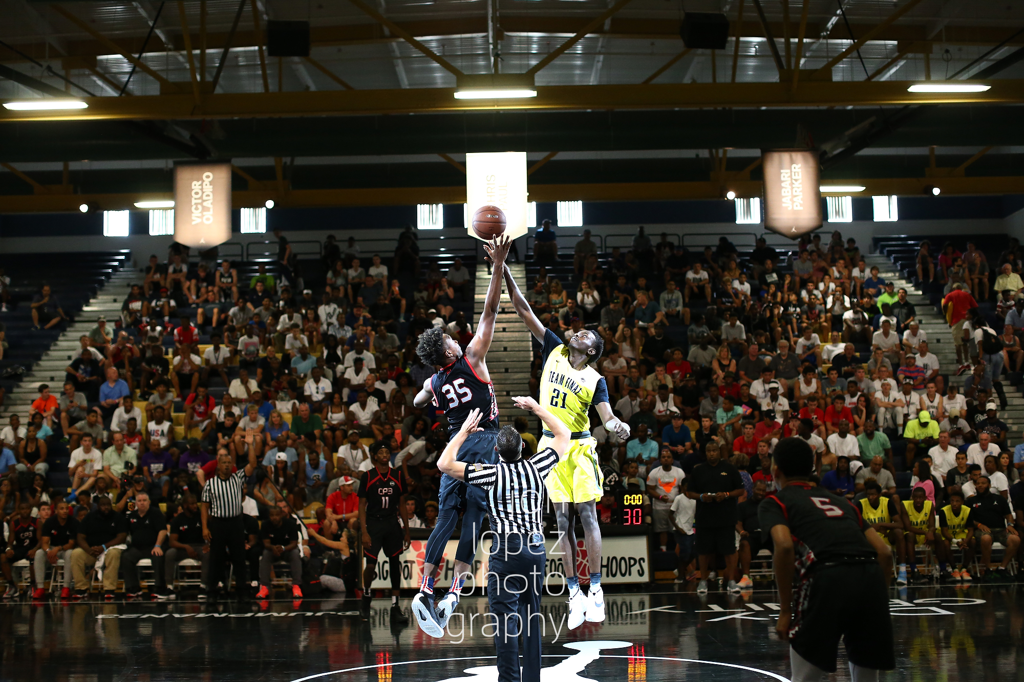 LAS VEGAS, NV. JULY 21, 2016. The Eight. Jump ball between Team CP3 and Team Final. (Mandatory photo credit: Jon Lopez/Nike).