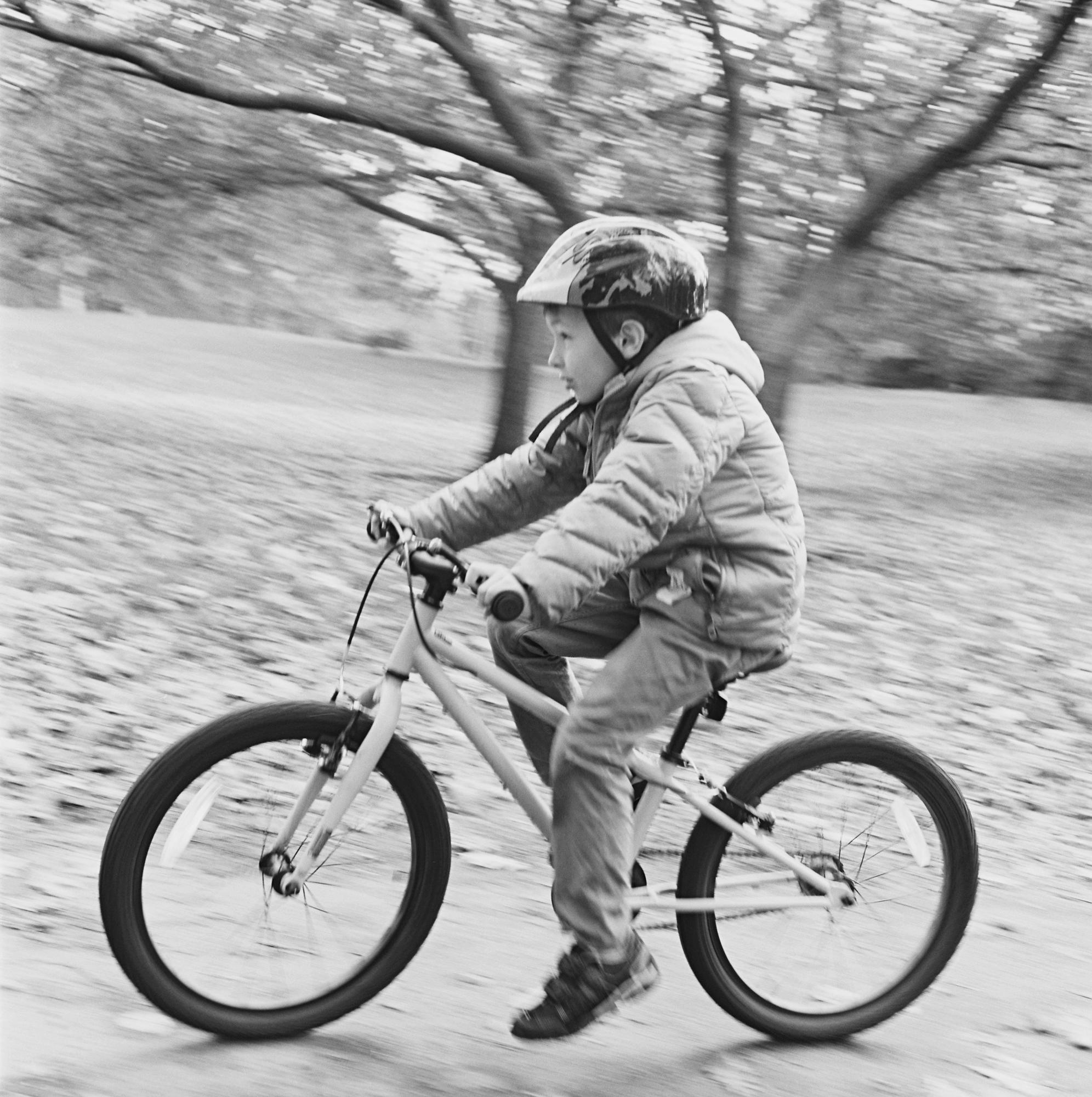 Boy rides bike in Prospect Park, Brooklyn.