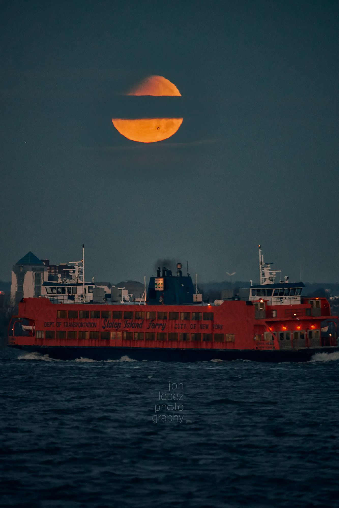 Back on digital, I was able to capture the full ferry, a bird flying in front of the moon, and a cloud cutting straight across the moon. Photo credit: Jonathan Lopez