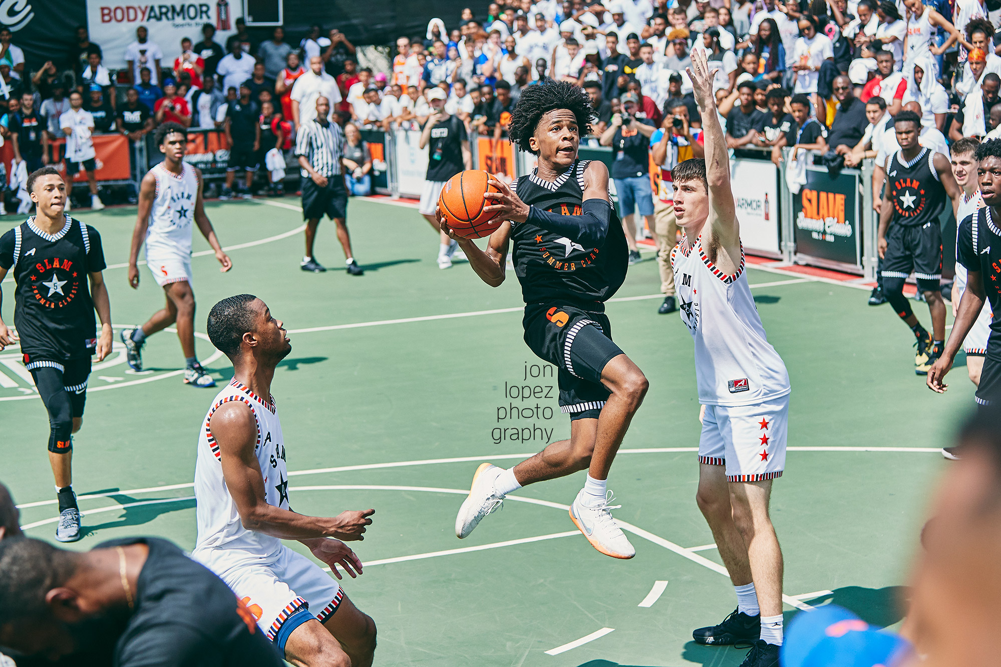 Sharife Cooper glides to the basket during the  SLAM Summer Classic.