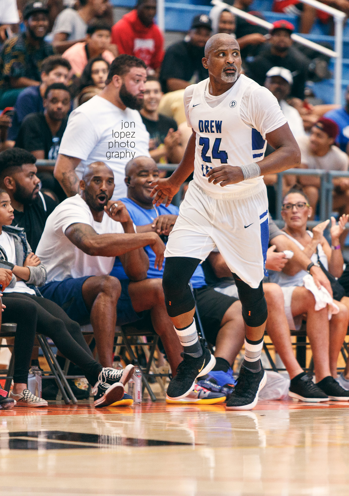 Kobe Bryant encourages Cuttino Mobley from the sidelines of the Drew League championship.