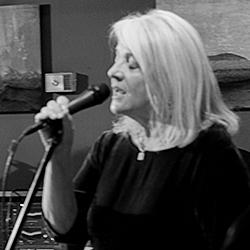 Suzie Singing BXW SQcrop 250dpi.jpg