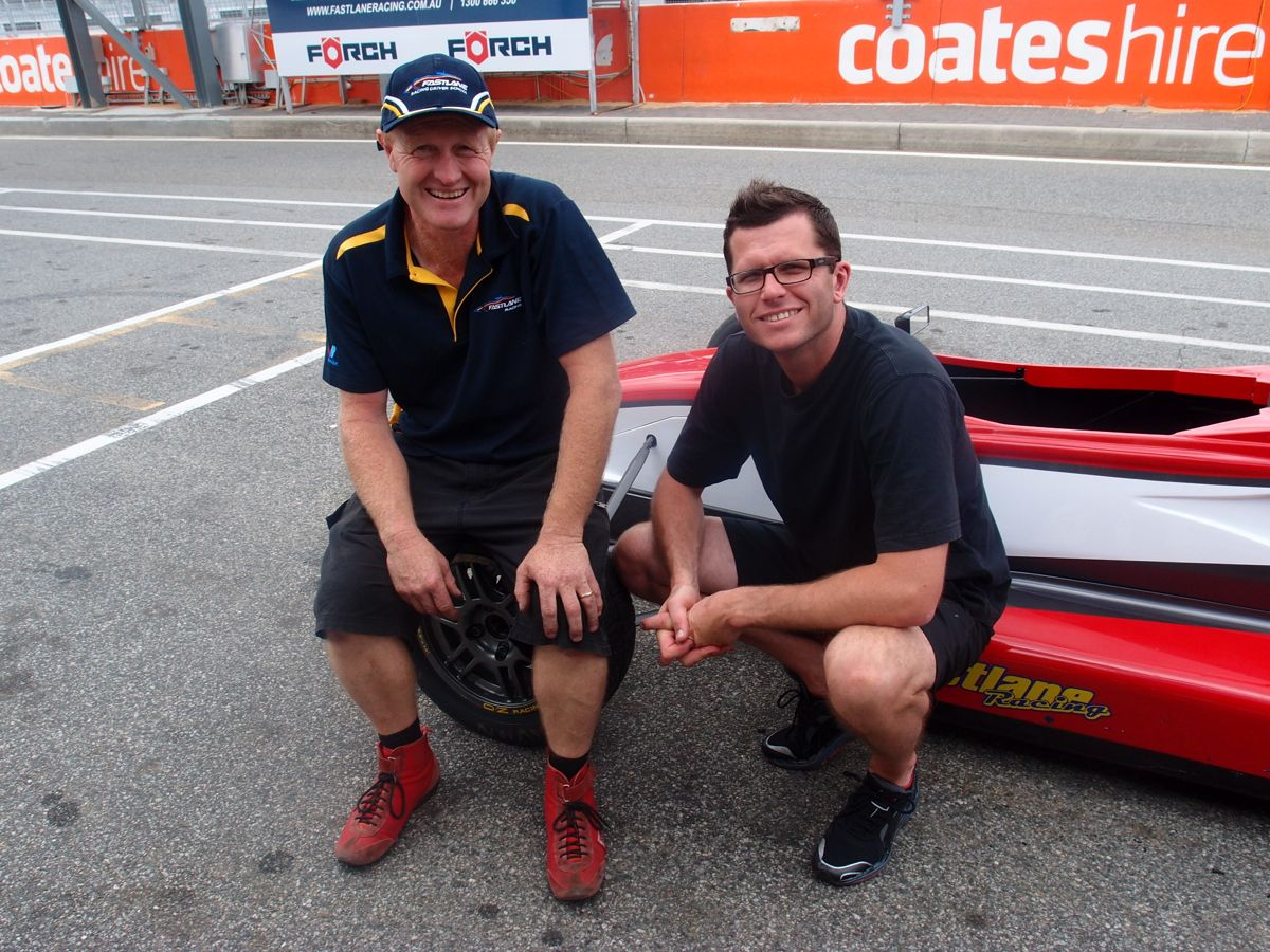 Brett Lupton and Garth Tander on the track at Barbagallo Raceway