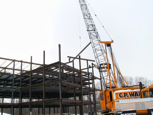 Iron workers erecting steel on Unity Health System, 2010.