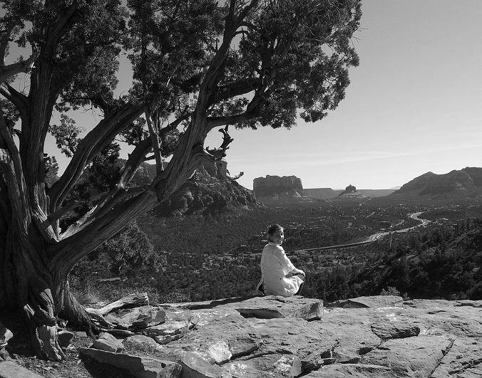 Cara Marie Petrone meditating, or trying to, in the hills overlooking Sedona.