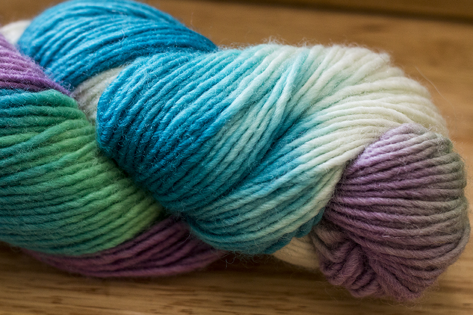 An example of a hand-painted yarn; notice the large sections of colors together in the skein