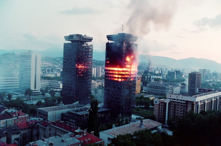 "The ""Momo"" and ""Uzeir"" towers burn on Sniper Alley in downtown Sarajevo on June 8, 1992 (Getty)"