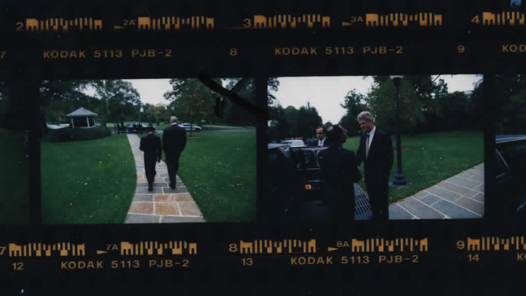 President Clinton and Aristide walking on October 14, 1994 (Photo sheet: P020767)