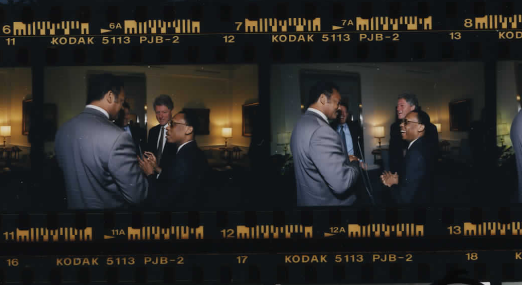 Jesse Jackson at the White House with Jean-Bertrand Aristide, President Clinton, and Vice President Gore on October 14, 1994 (Photo sheet: P020769)