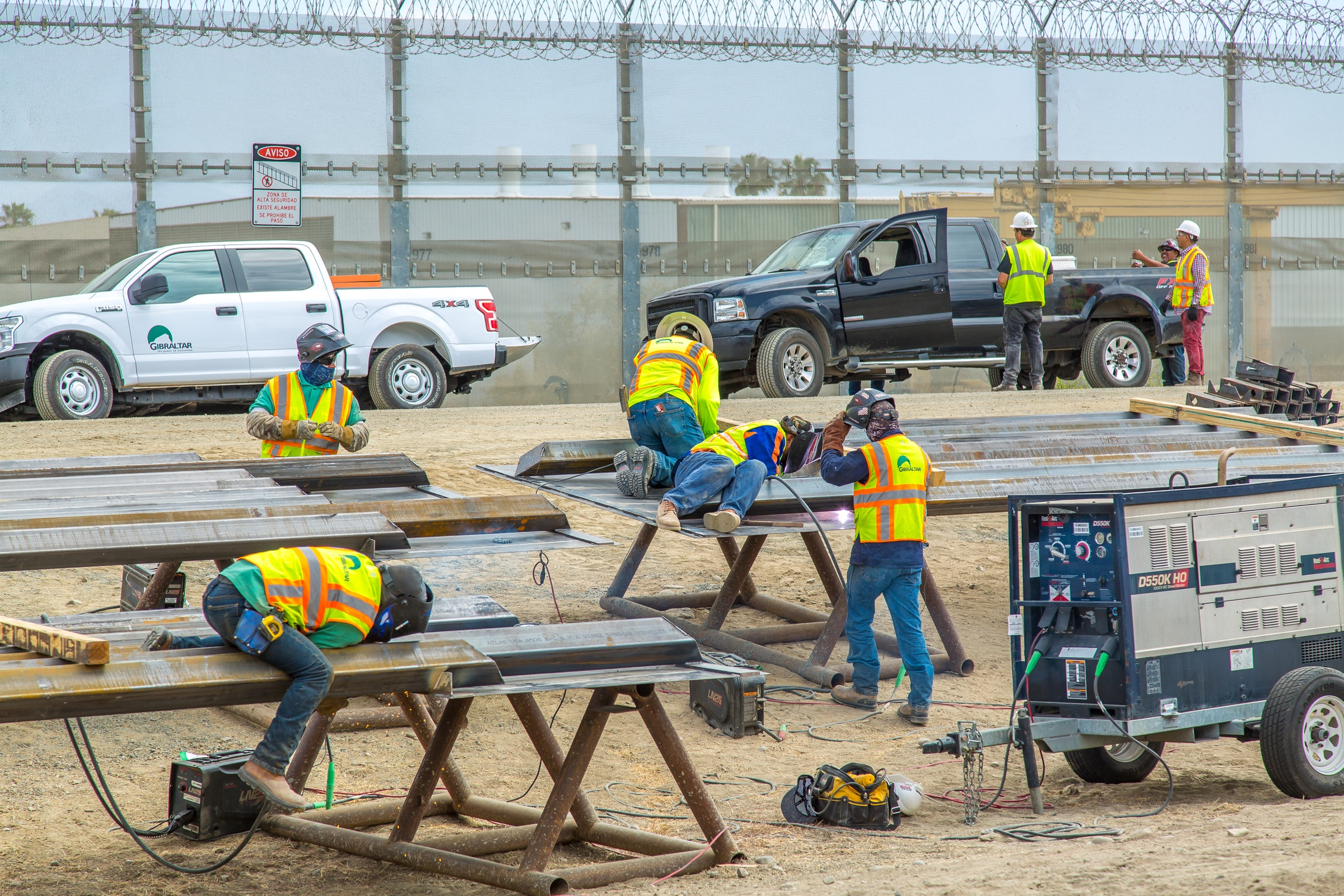 "Caption from CBP: ""Construction workers putting up new wall at the border located at the Chula Vista Area of Responsibility, California, on June 19, 2018. Seen here construction workers are assembling the new wall panels onsite."""