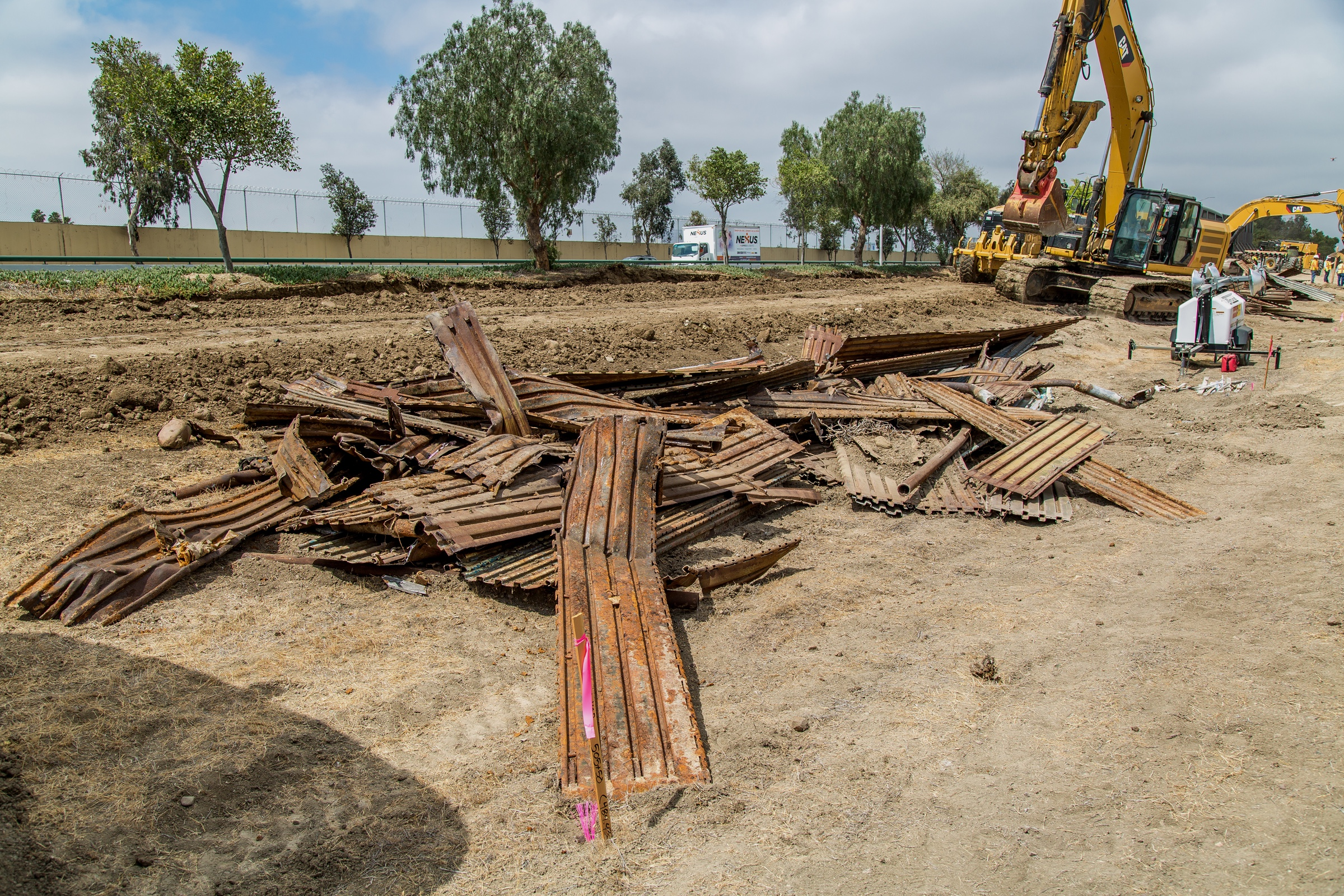 "Caption from CBP: ""Construction workers putting up new wall at the border located at the Chula Vista Area of Responsibility, California, on June 19, 2018. Seen here are scrap pieces of the old border fence."""