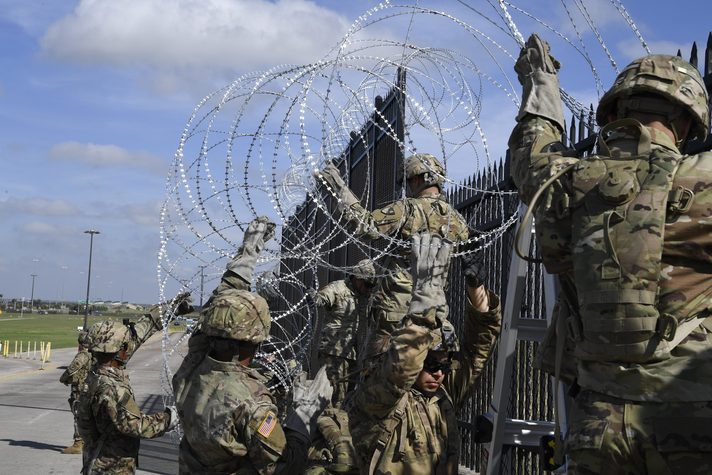 U.S. soldiers install concertina wire Nov. 5, 2018, on the Anzalduas International Bridge, Texas. (US Air Force photo by Airman First Class Daniel A. Hernandez)