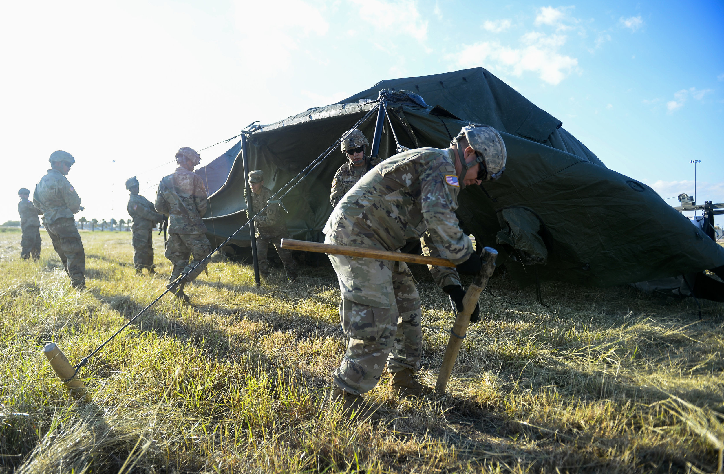 Soldiers with the 19th Engineering Battalion, 41st Clearance Company, Fort Riley, KS., build tents and set-up camp grounds near the Mexican border at Donna, TX., port of entry, in support of Operation FAITHFUL PATRIOT November 3, 2018. (U.S. Air Force photo by SrA Alexandra Minor)