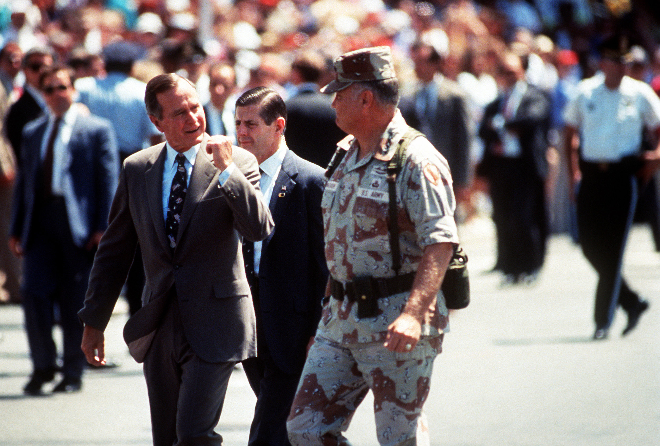 U.S. Army Gen. H. Norman Schwarzkopf (center), commander in chief, U.S. Central Command, walks to the reviewing stand with President George H.W. Bush (left) at the beginning of the National Victory Celebration parade in Washington, D.C., June 8, 1991. The day-long celebration is being held in honor of the coalition forces that liberated Kuwait during Operation Desert Storm. (Courtesy Photo)
