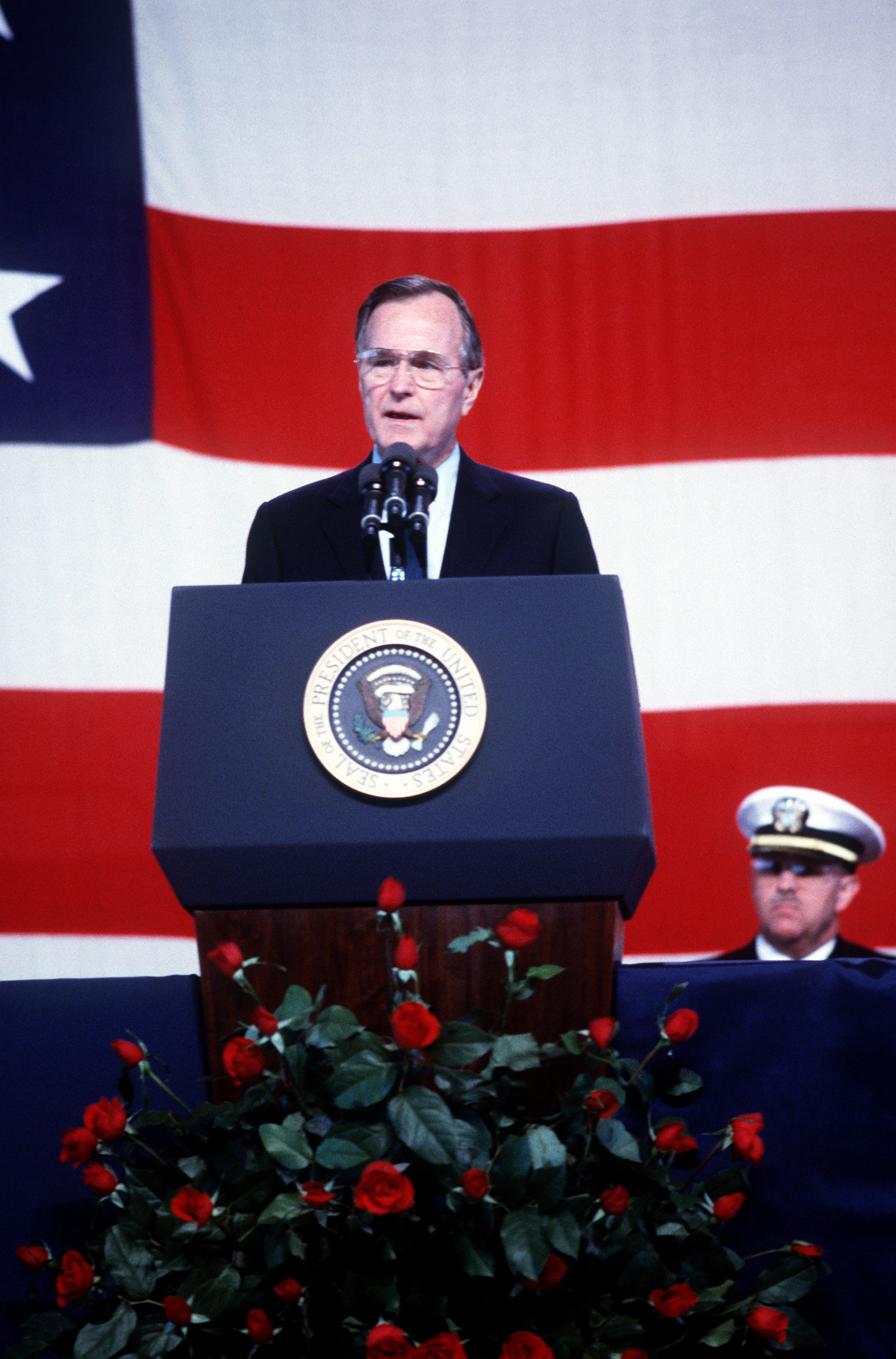 President George H.W. Bush speaks during a memorial service for 47 crew members killed in an explosion aboard the battleship USS Iowa (BB-61). The explosion occurred in the No. 2 16-inch gun turret as the Iowa was conducting routine gunnery exercises approximately 300 miles northeast of Puerto Rico on April 19th.