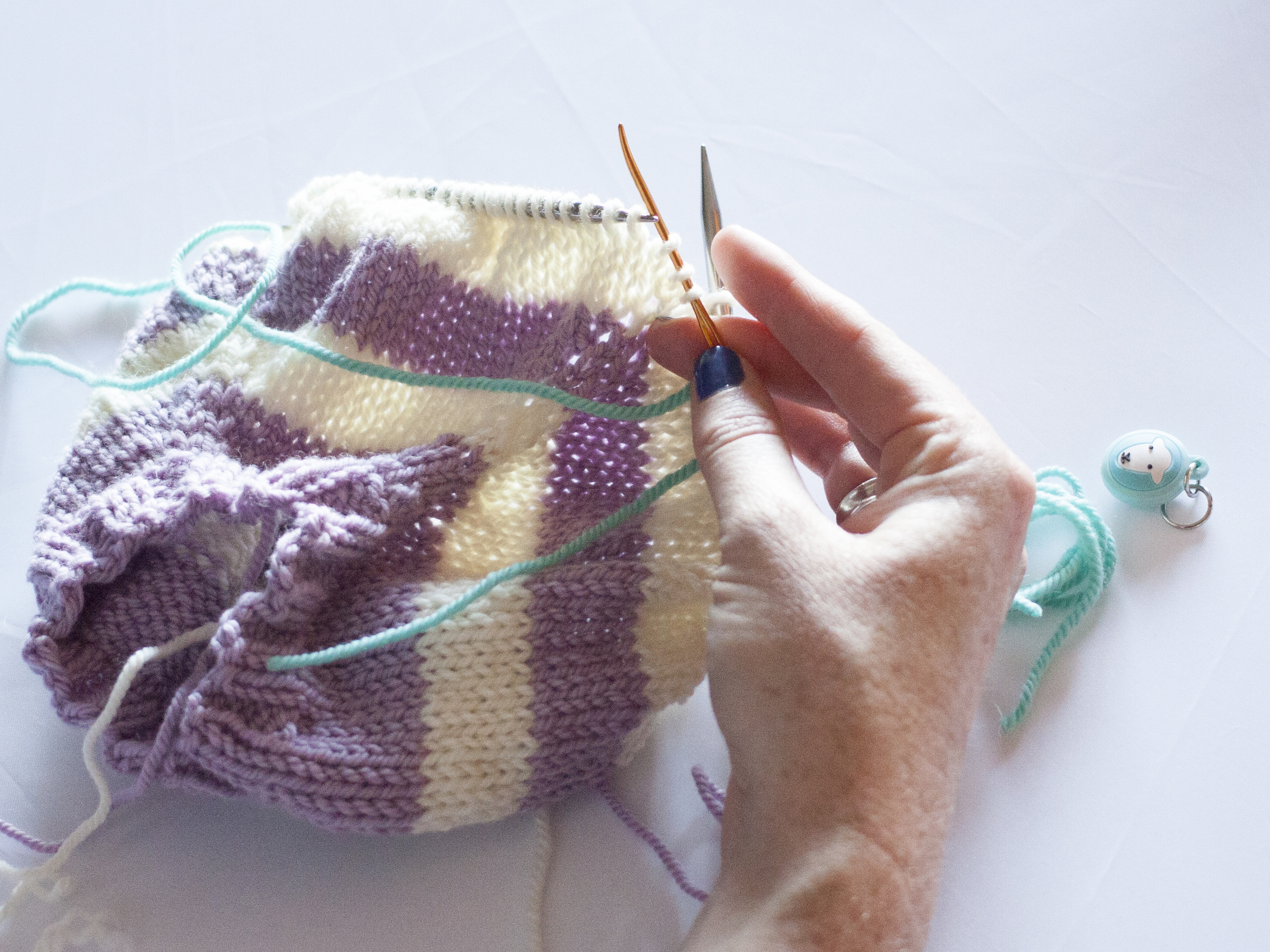 Moving stitches to waste yarn