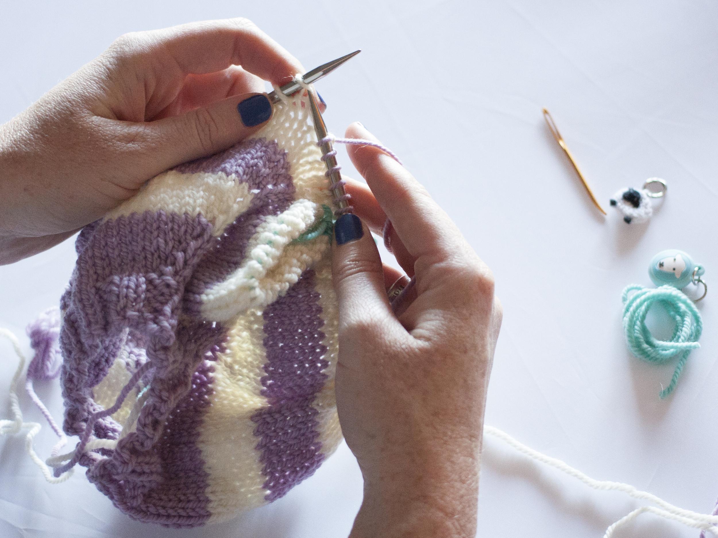 Continue knitting around the row