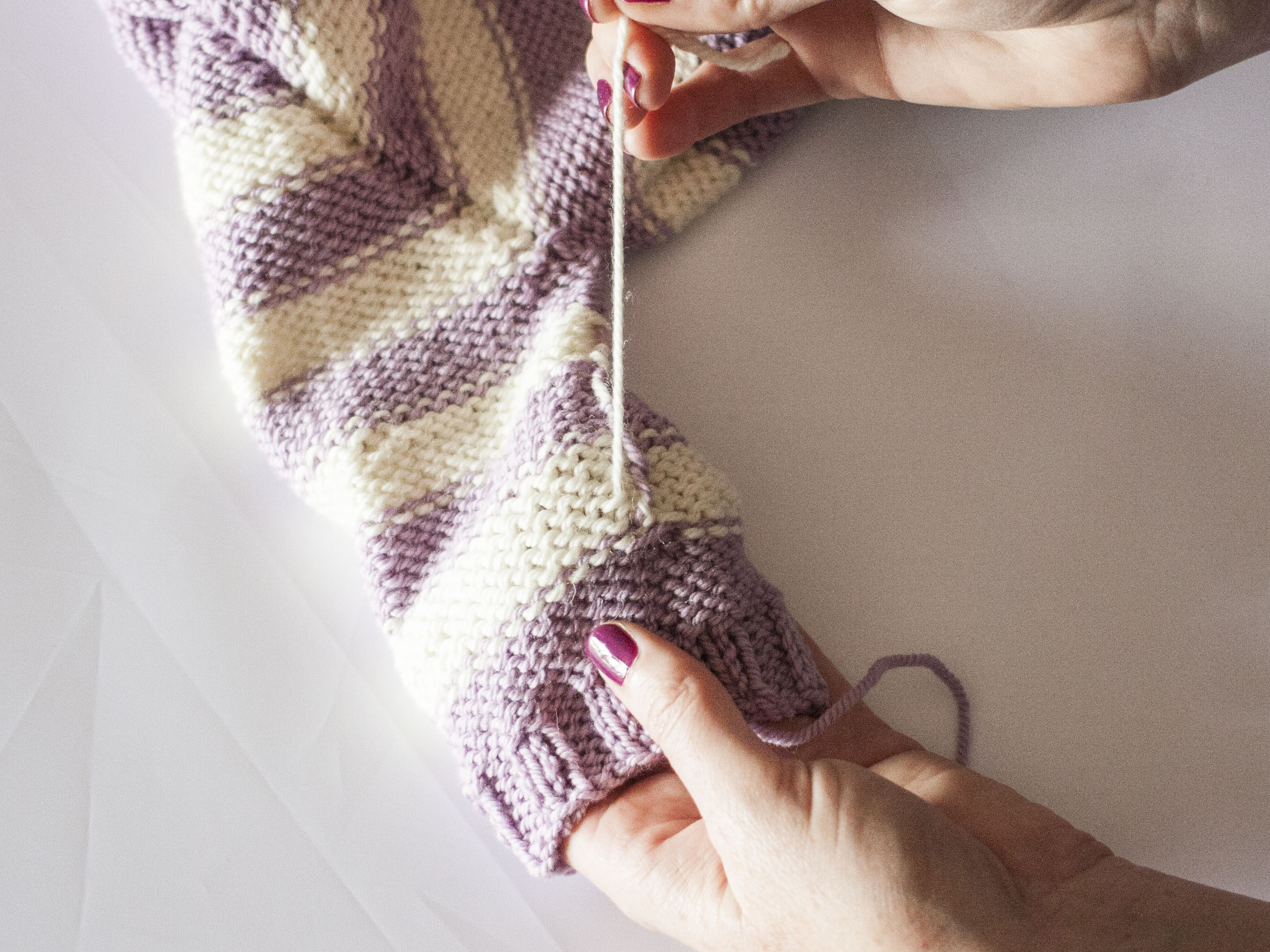 Weaving in yarn ends on a sweater