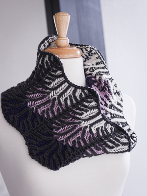 Lilac Vines  brioche cowl knitting pattern designed by Meaghan Schmaltz in Ewe Ewe Wooly Worsted yarn.