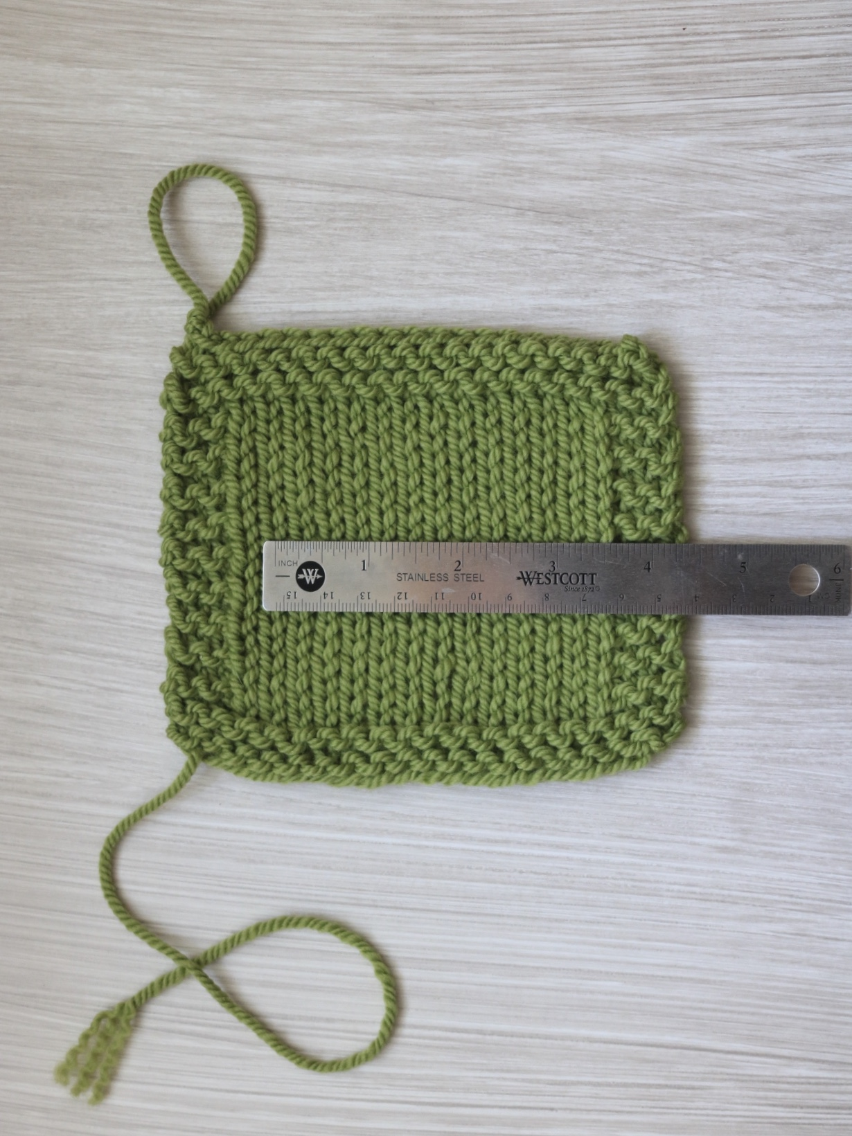 Reading the stitch count on a knitting gauge swatch