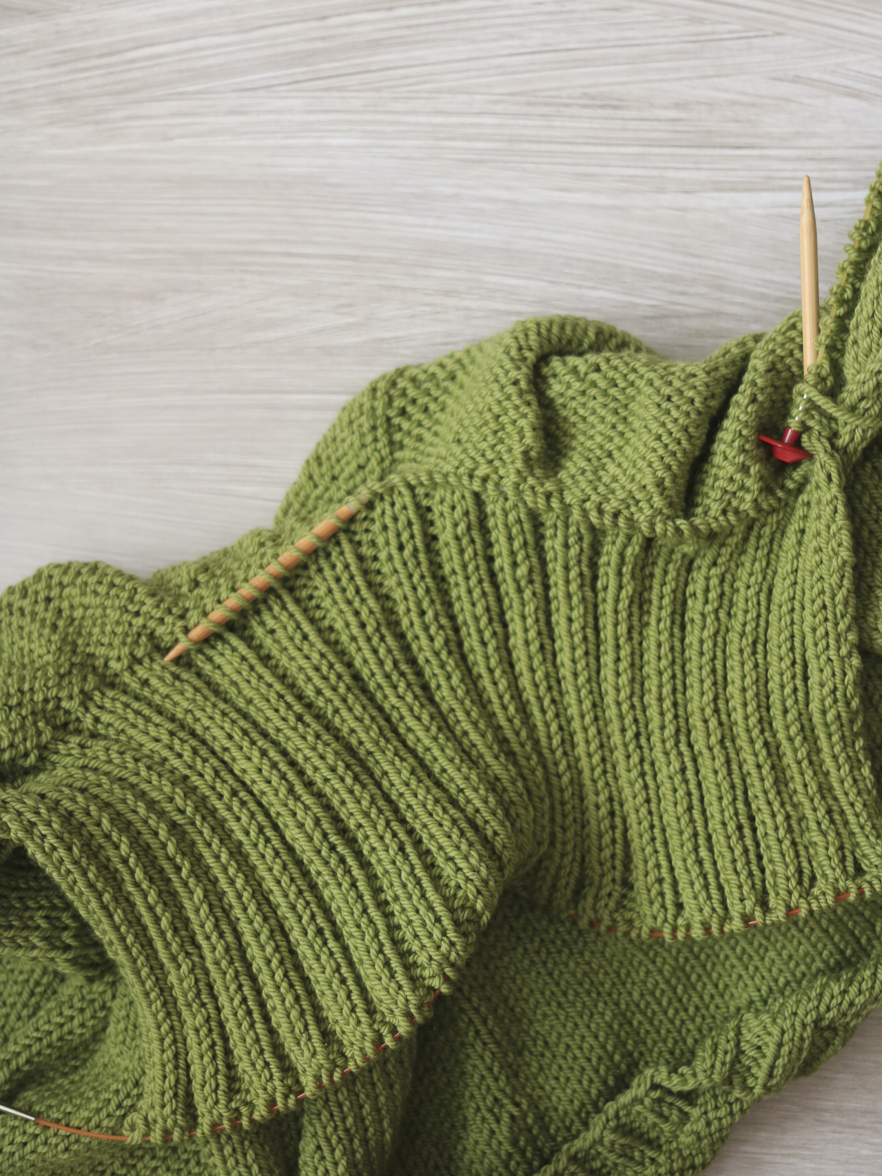 Picking up stitches at the neckline of a Carbeth Cardigan.